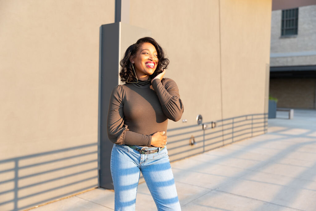 Andrea Fenise Memphis Fashion Blogger and Memphis influencer styles a denim wide leg pant for fall