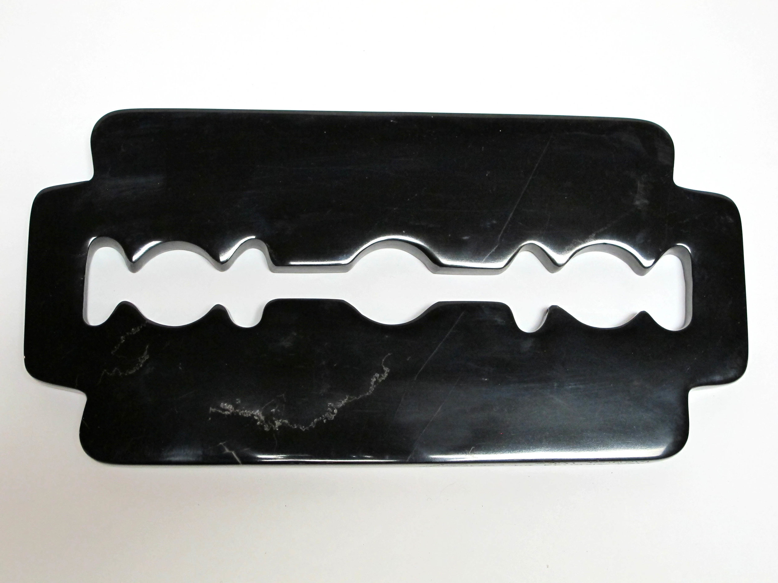 KL_The-Razor Blade_Black-Marble_13x8.jpg