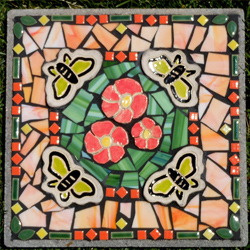Nancy Mosely   Mosaic Art    Several years ago I became interested in making art for the outdoors. My vision is to place art amongst the natural beauty in nature. This series of mosaic stepping stones is created with a variety of materials that embrace an outdoor environment including a combination of tile, stained glass, glass beads and my own shaped clay tiles.     Visit Artist's Website