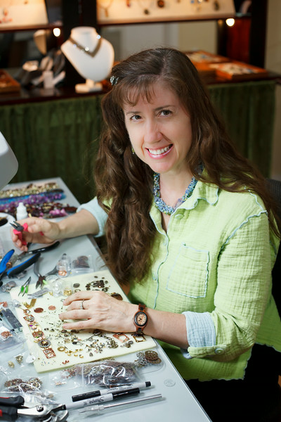 """Susan Crane   Mixed Media Jewelry   Welcome to """"A Crane Creation""""—where polymer clay, fused glass, chainmaille, beads, found objects, metal work, resin, photographs, wire crochet, passion and play join together in fabulous jewelry art and couture home dècor. The aesthetics range from: whimsical to elegant; O'Keefe to Mondrian; a whisper to a shout. By teaching jewelry-making classes, I also have the pleasure of supporting others as they explore their creativity in a fun, supportive environment."""