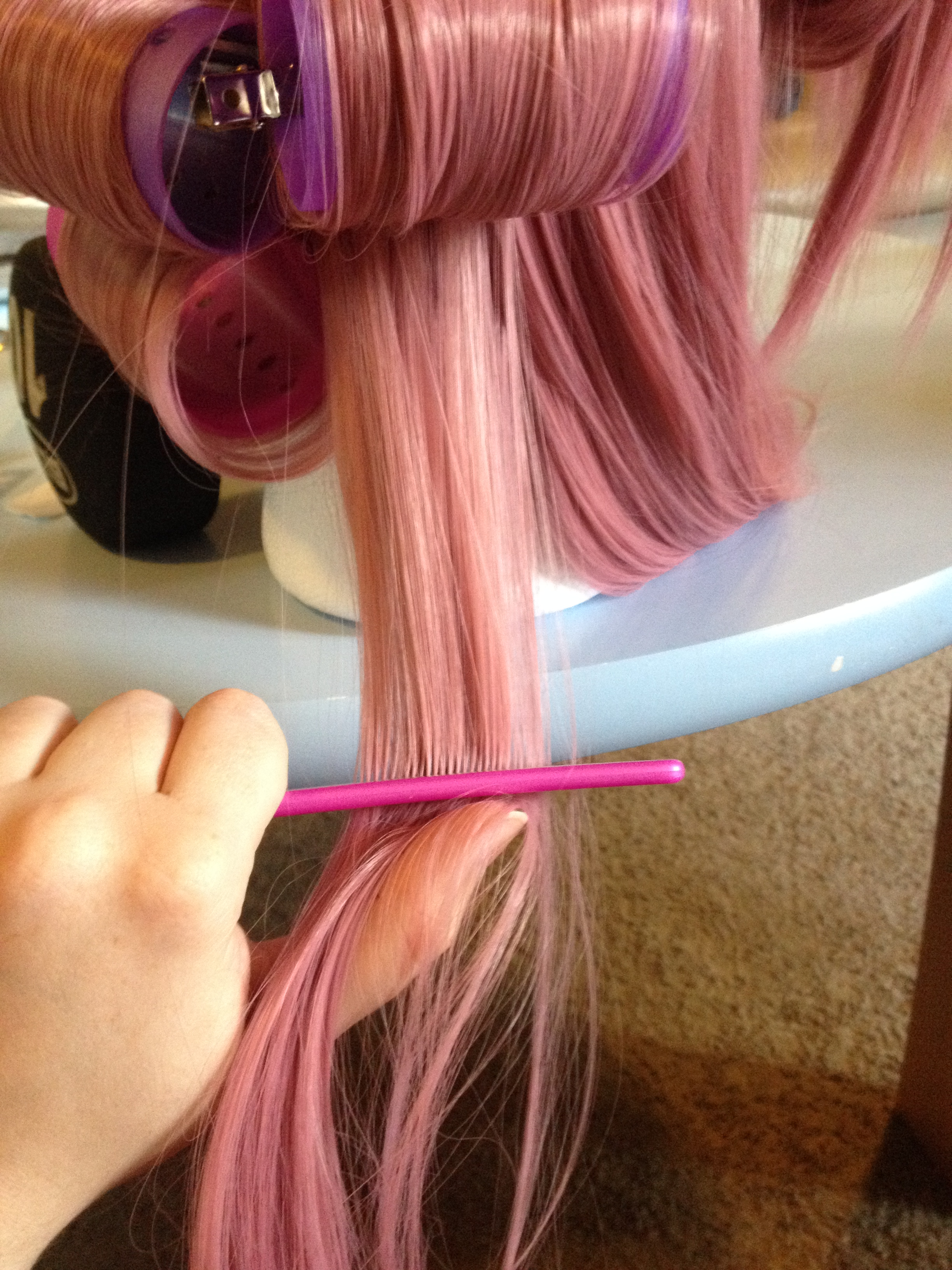 And then I'd clip it shut. I'm not sure if all synthetic wigs are as slick as mine, but the hairspray I used definitely made it easier to work with just by making the hair stickier.