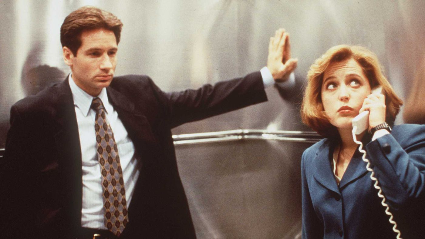 Mulder contemplates the weird-ass photo shoots they've done over the years.