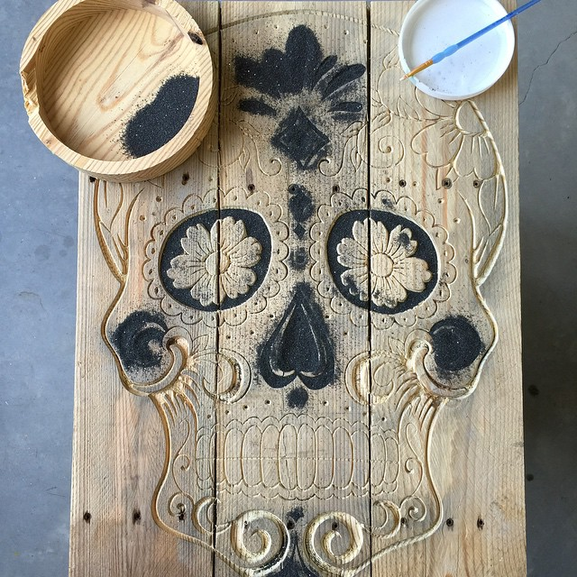 Sugar Skull made from reclaimed wood and black sand