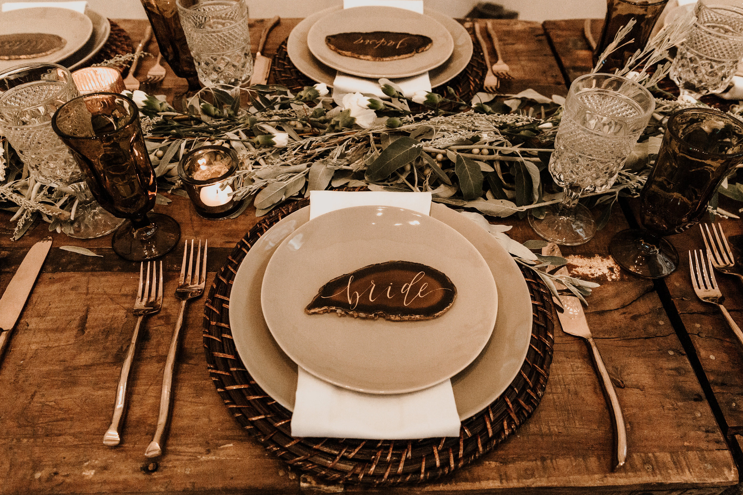 Smokey, earthy vibes at a private event. We are in love with these grey stoneware plates and rattan chargers. Photography  K. Gabrielle Photography , styling and rentals  Curated .