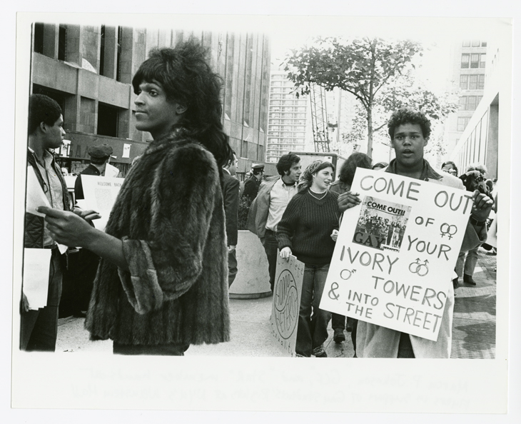 Diana Davies Untitled (Marsha P. Johnson Hands Out Flyers For Support of Gay Students at N.Y.U.), c. 1970 Digital print, 11 x 14 in. © The New York Public Library/Art Resource, New York.