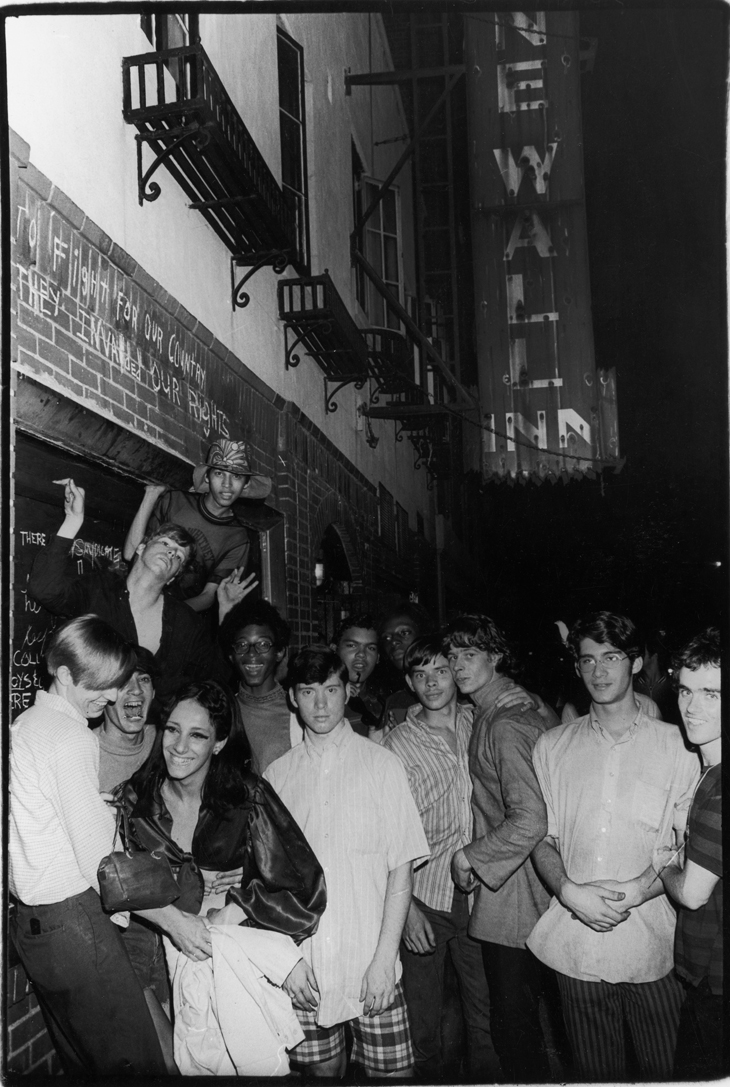 Fred McDarrah Celebration After Riots Outside Stonewall Inn, Nelly (Betsy Mae Koolo), Chris (Drag Queen Chris), Roger Davis, Michelle and Tommy Lanigan-Schmidt, June 1969, 1969 Gelatin silver print, 8 1/2 x 11 in. Collection Pavel Zoubok. Courtesy Pavel Zoubok Gallery, New York. Photo: Fred W. McDarrah/Getty Images