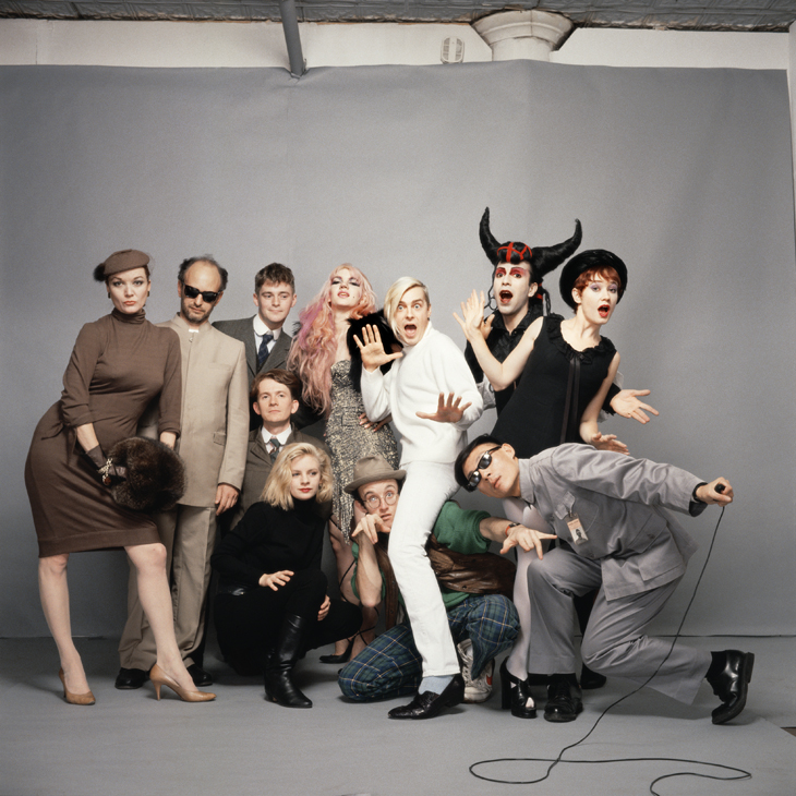 Tseng Kwong Chi Art After Midnight (New York), 1985 Chromogenic print, 30 x 30 in. © Muna Tseng Dance Projects, Inc. Standing from left: Patti Astor, Steve Maas, Peter McGough, Animal X, John Sex, Joey Arias, Ann Magnuson. Kneeling from left: David McDermott, Min Thometz-Sanchez, Keith Haring, Tseng Kwong Chi