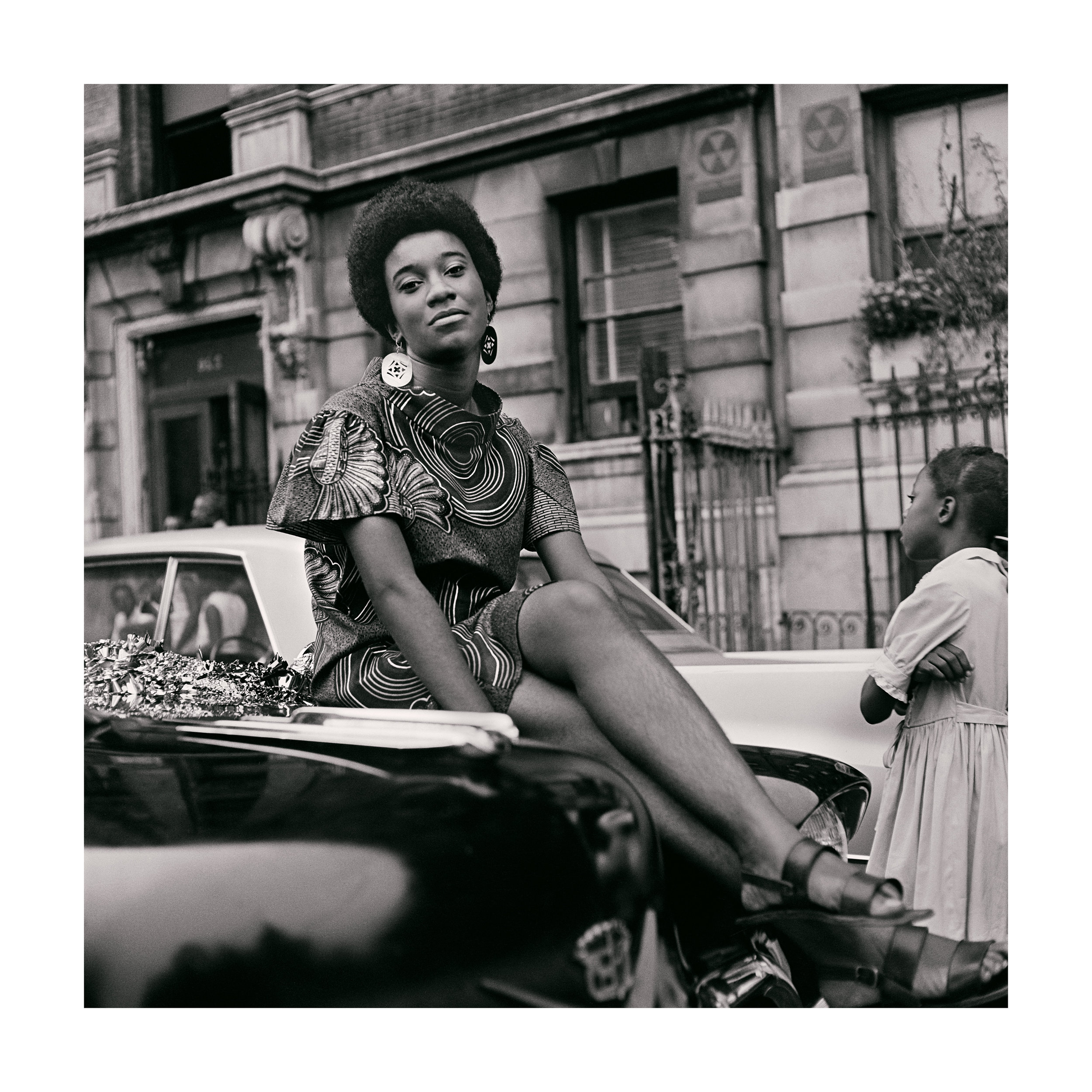 Kwame Brathwaite. Grandassa Model on car during Marcus Garvey Day celebration, Harlem, ca. 1968.Courtesy of the artist and Philip Martin Gallery, Los Angeles.