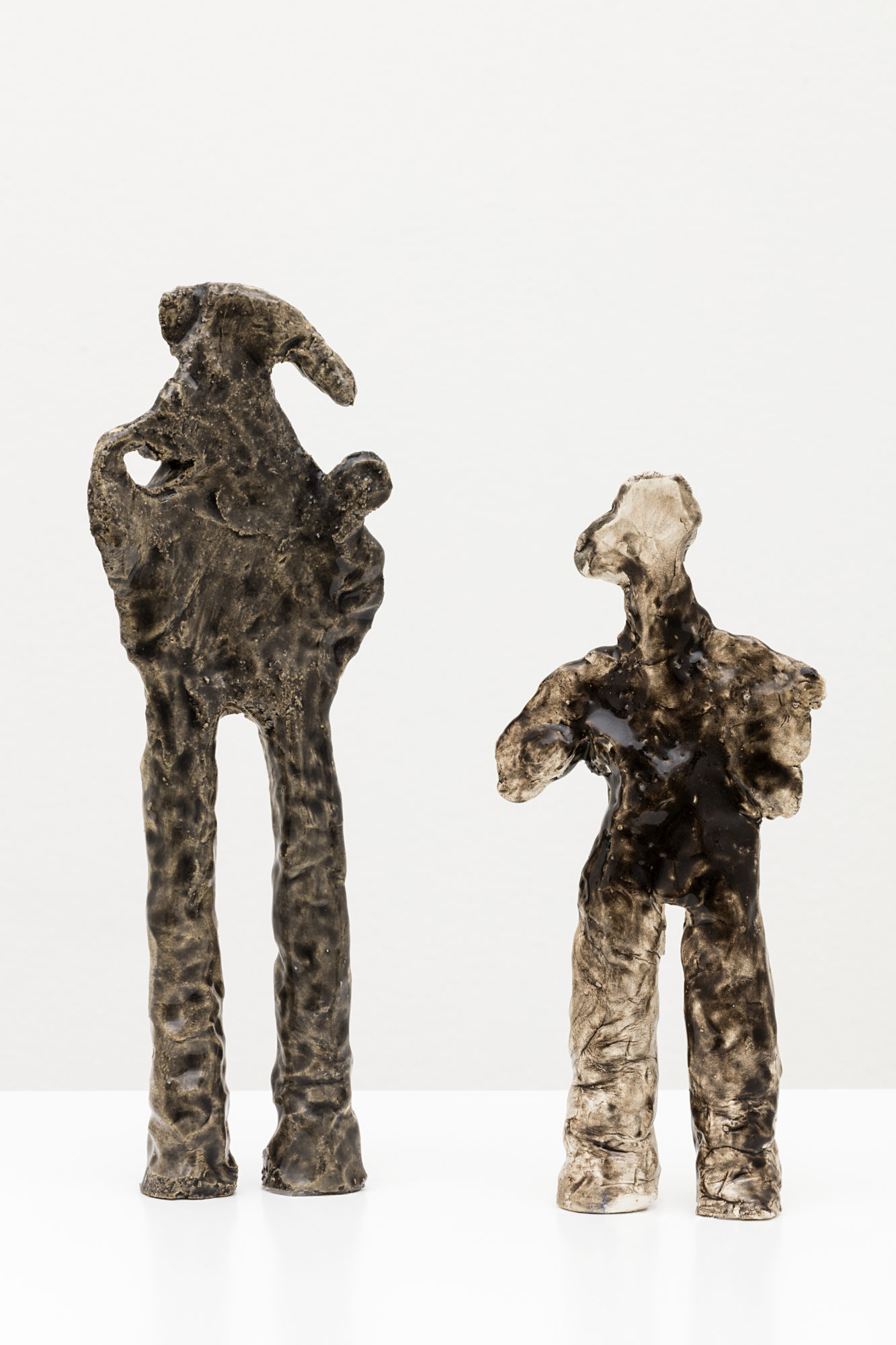 "Simone Fattal. ""Man and his shadow."" 2009. Glazed stoneware. 9.8 x 4.3 x 1.6 in. (25 x 11 x 4 cm). Courtesy of the artist and kaufmann repetto, Milan / New York; Balice Hertling, Paris; Karma International, Zurich / Los Angeles"