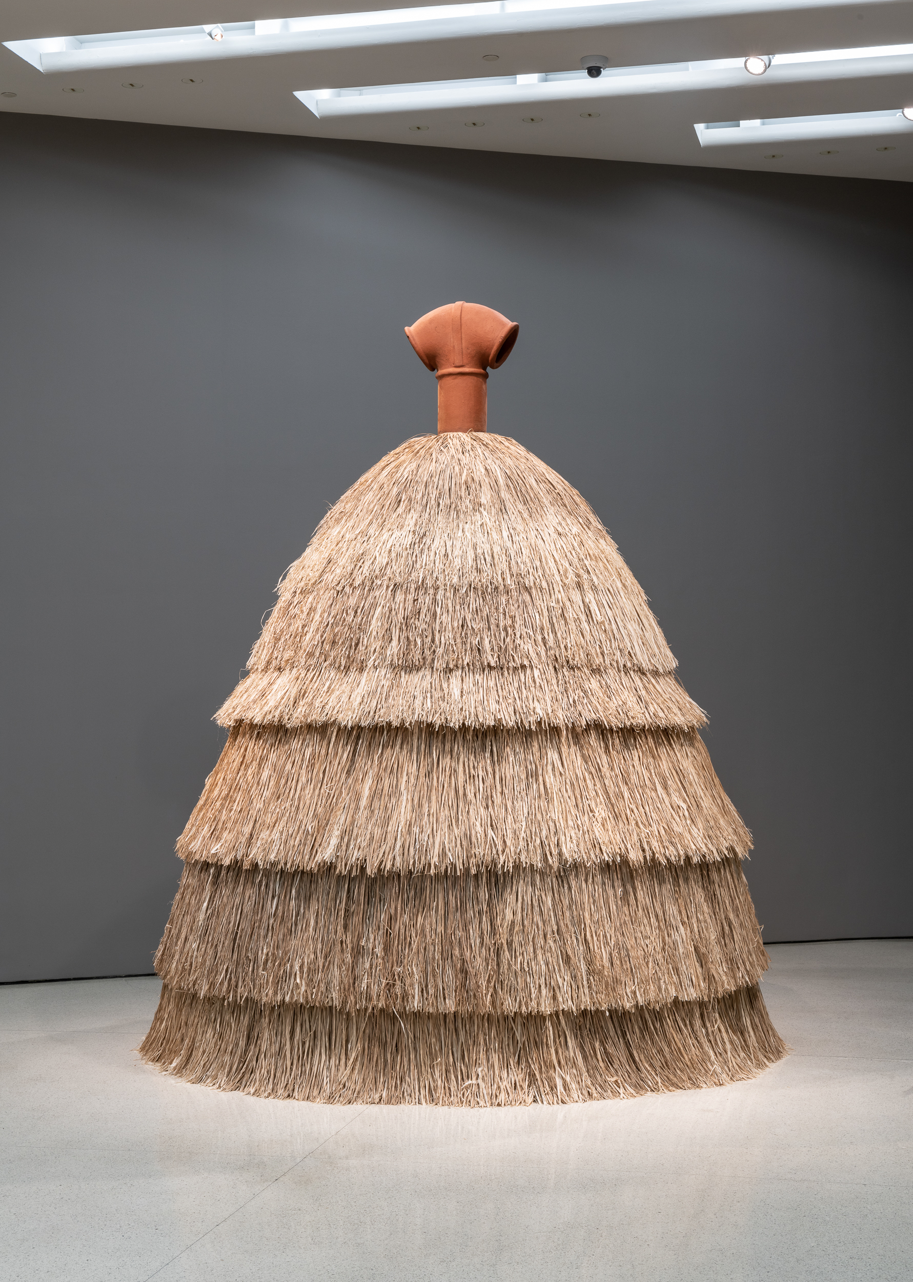 Simone Leigh  Panoptica , 2019 Terracotta pipe and chimney, steel, and raffia 317.5 x 304.8 cm Courtesy the artist and Luhring Augustine, New York Installation view:  The Hugo Boss Prize 2018: Simone Leigh, Loophole of Retreat , Solomon R. Guggenheim Museum, New York, April 19–October 27,2019. Photo: David Heald © 2019 The Solomon R. Guggenheim Foundation