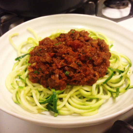 Bowl of healthy low carb, gluten free courgetti pasta with homemade dairy free pesto recipe.