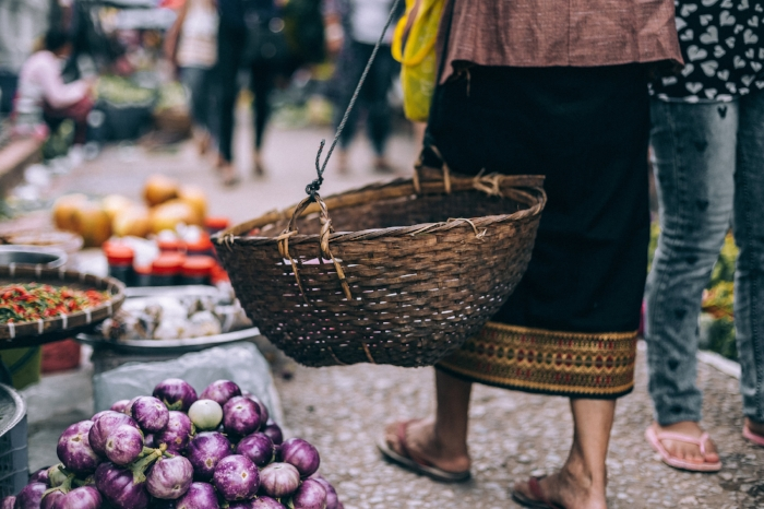 Lady in market of healthy organic food - fruit and vegetables