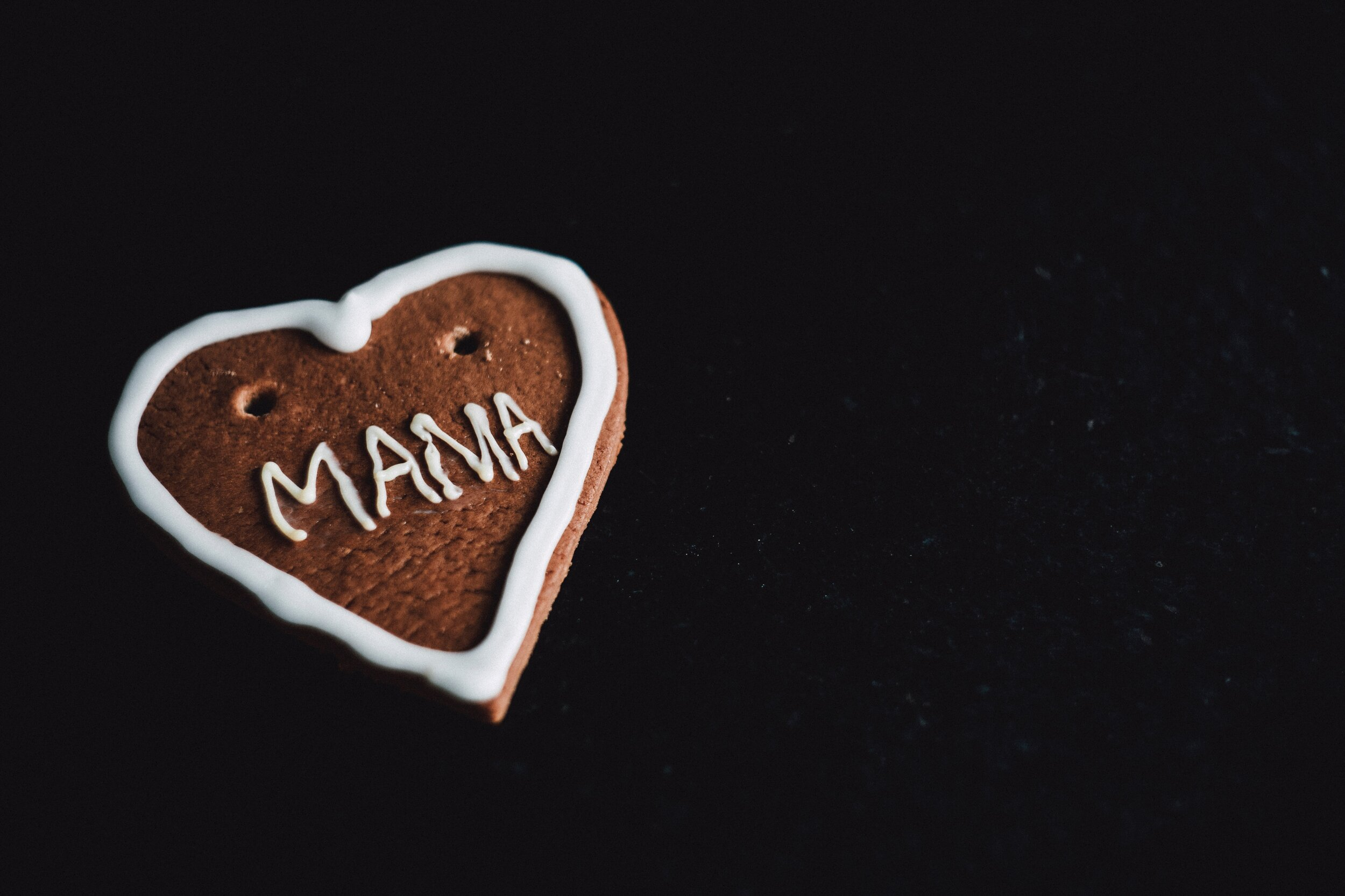 """photo of cookie with """"mama"""" decoration"""