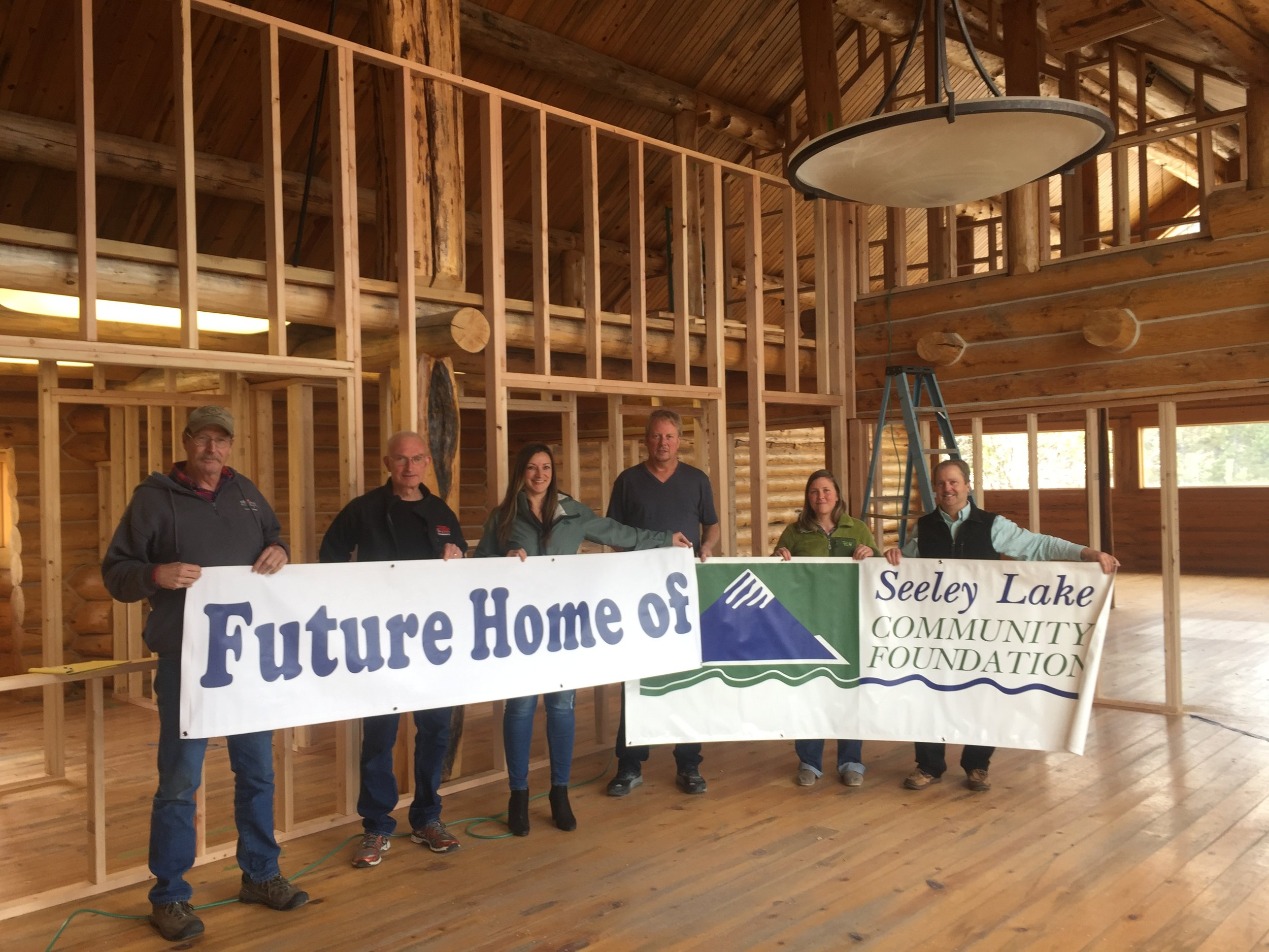 Future home of… - March: Current and former SLCF board members, excited about the new building!