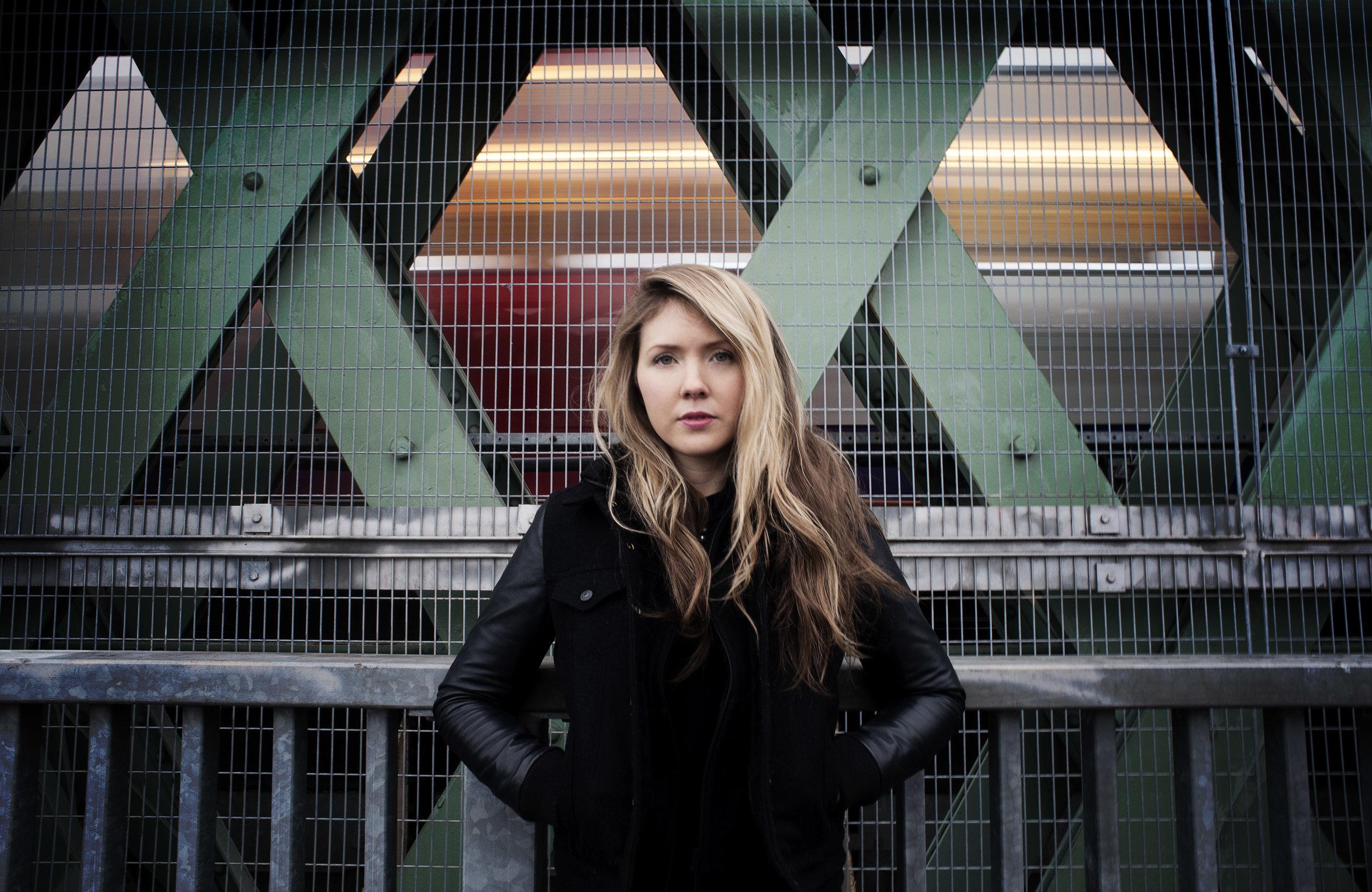 Beatie Wolfe standing on Putney Bridge London