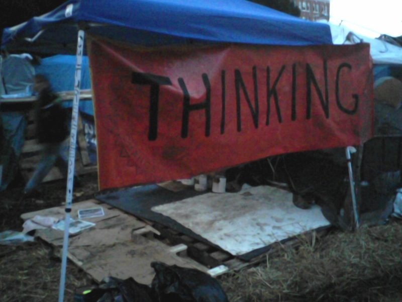 """I set up an """"art studio"""" at the camp to make protest signs, and made a second """"Thinking"""" banner for it."""