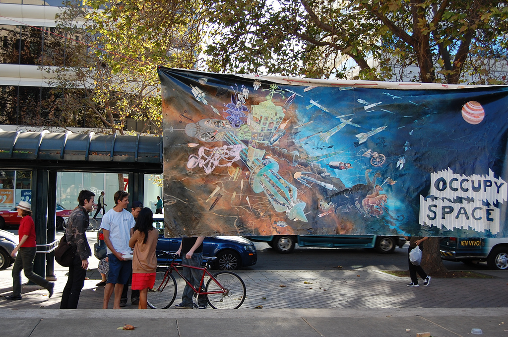 In front of Oakland city hall, I hung up a 2006 painting depicting a future Martian Occupy encampment.