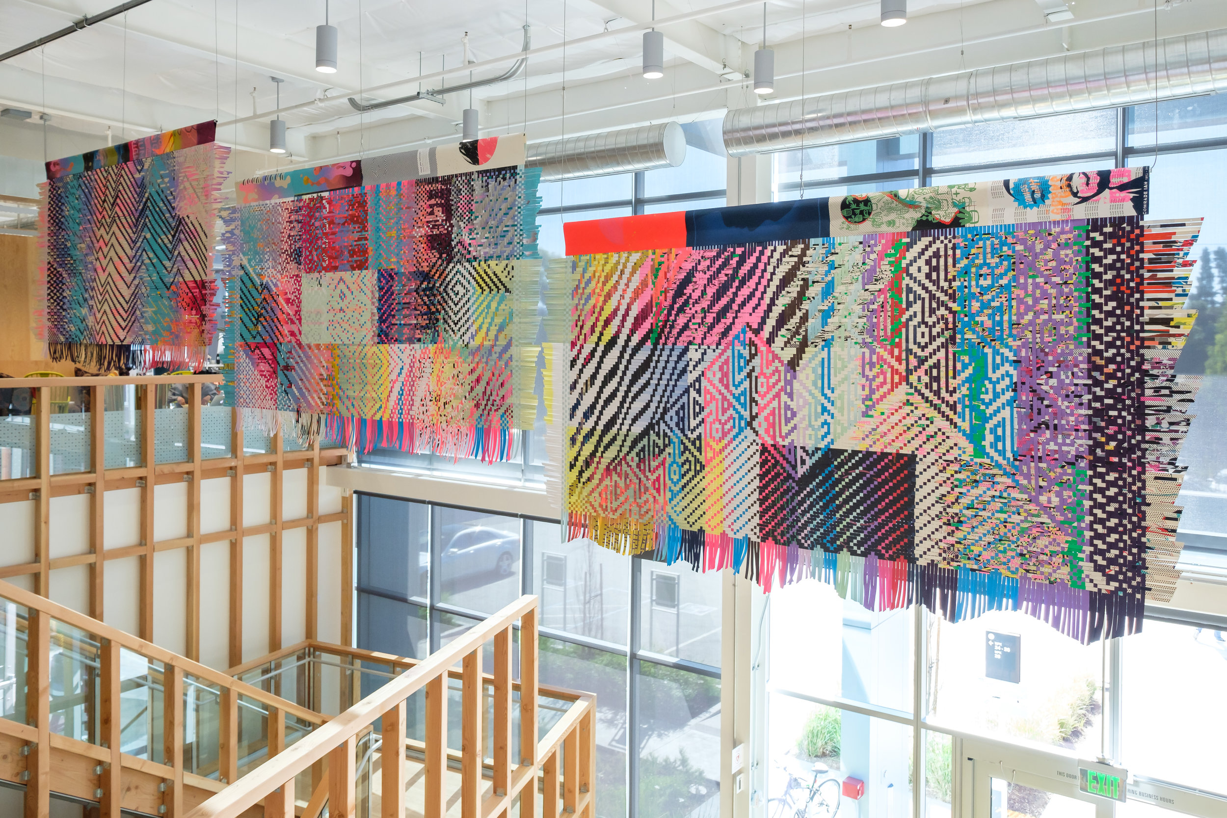 FB, 2018, woven silkscreen posters, 27ft x 8.5ft, Commissioned by Facebook Artist in Residence Program