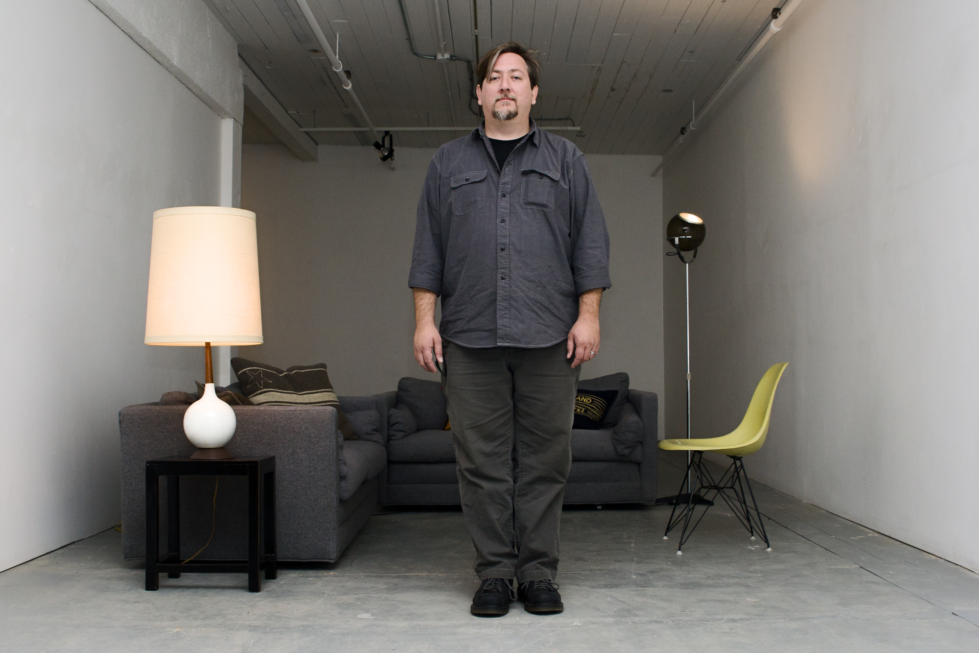jon_scarper_in_furniture_room_portrait_web.jpg