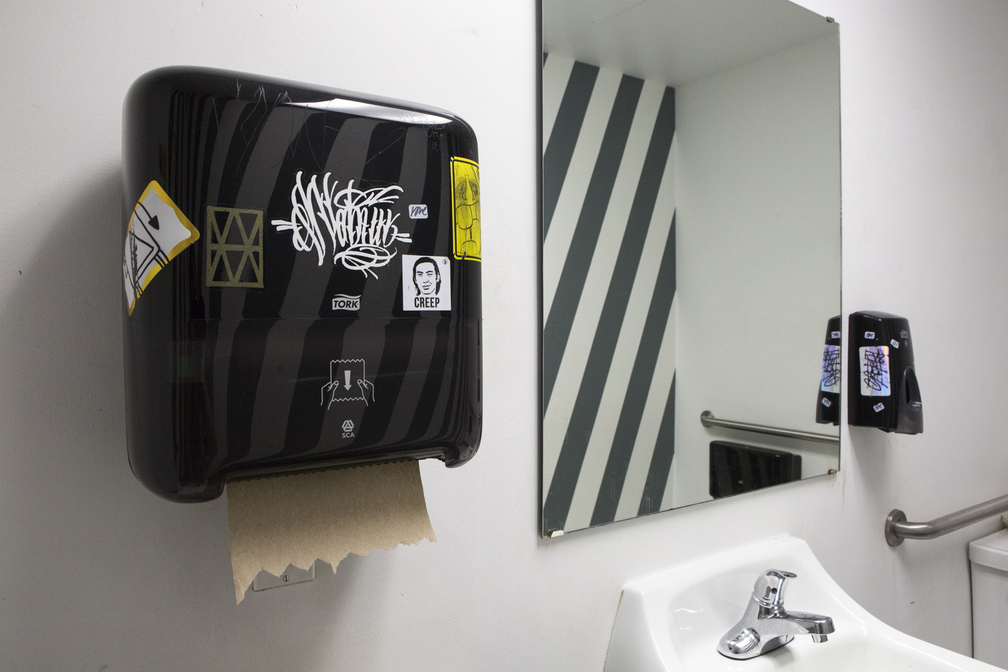 bathroom_interior_with_towel_dispenser_web.jpg