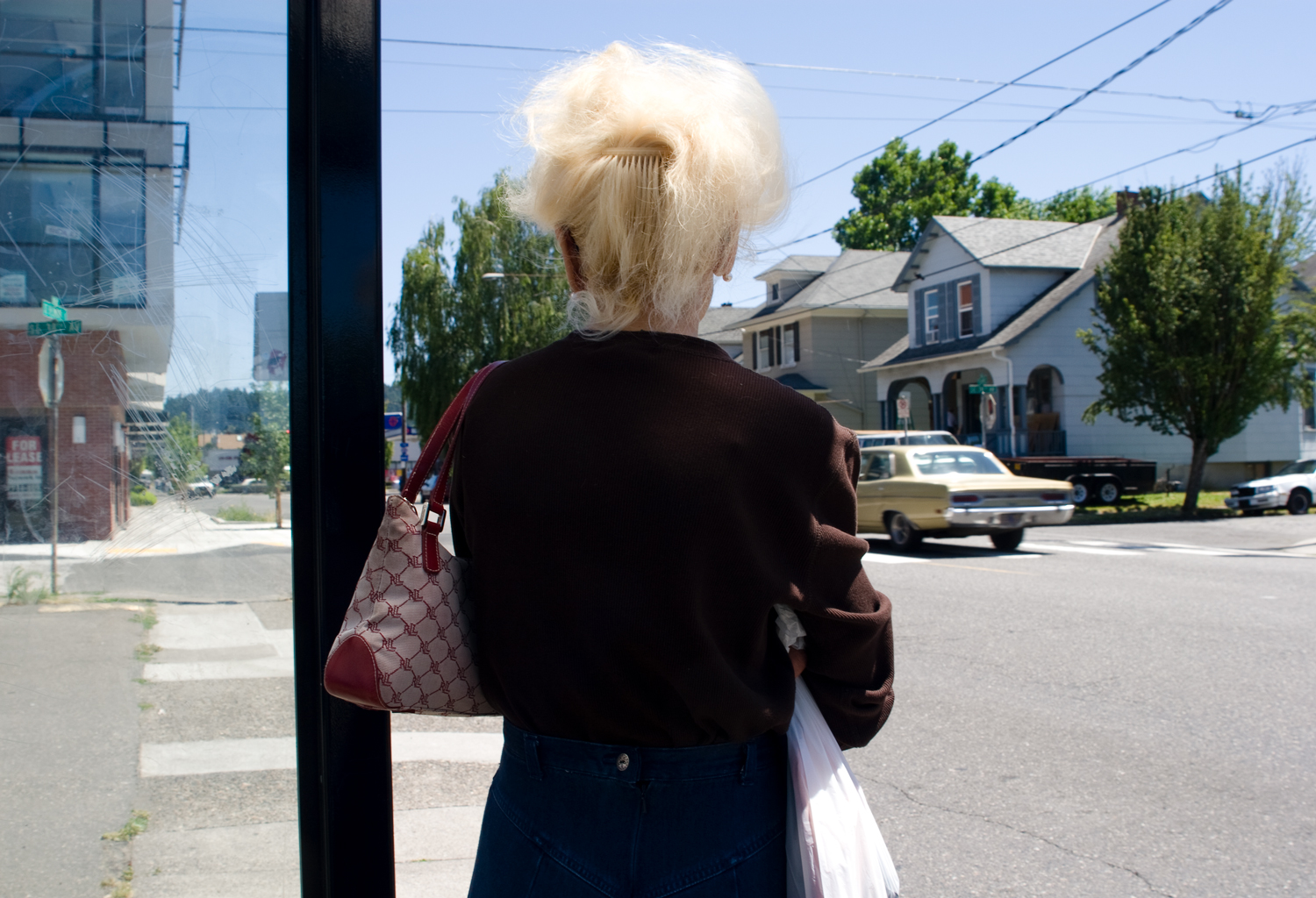 older_woman_standing_at_a_bus_stop_portfolio_web.jpg