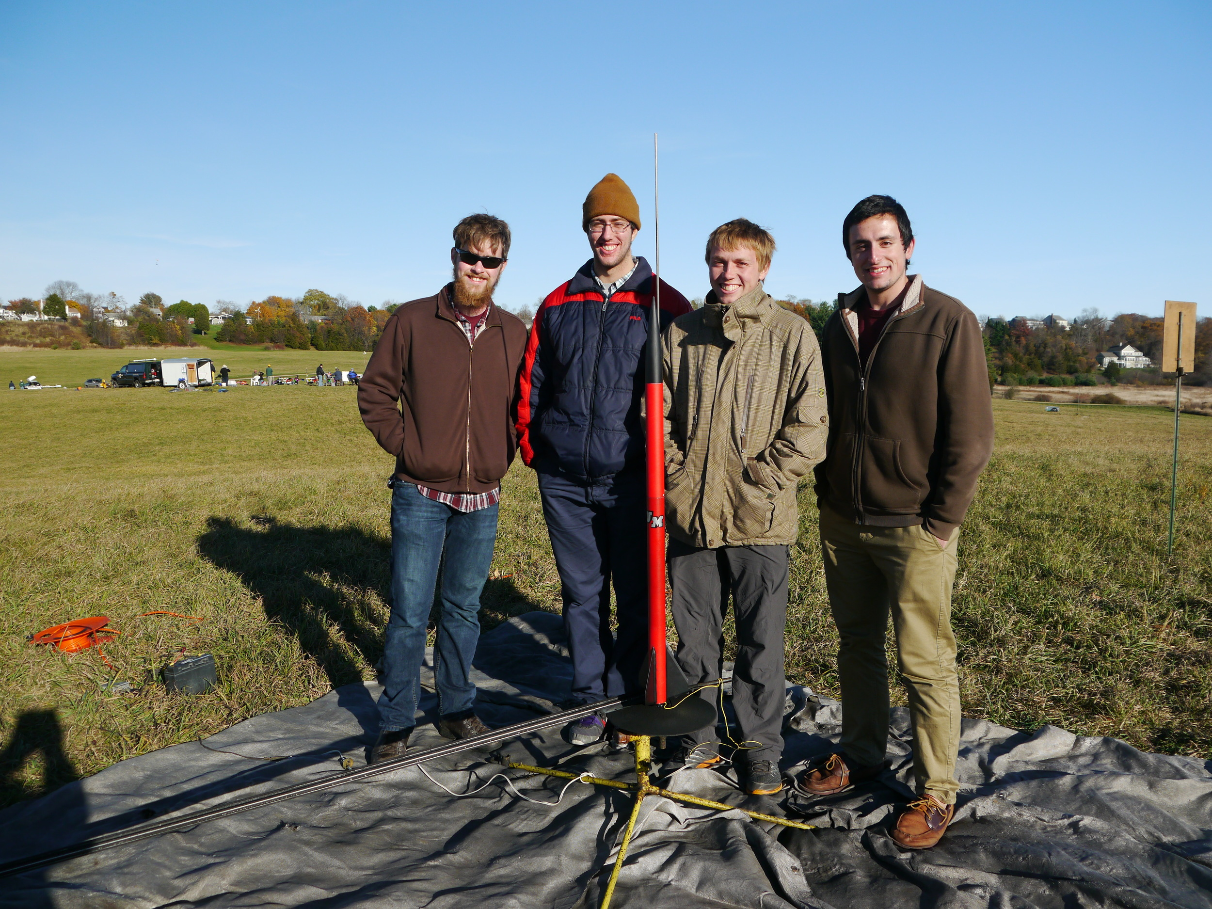 The UMass Student Launch Team with their first vehicle.