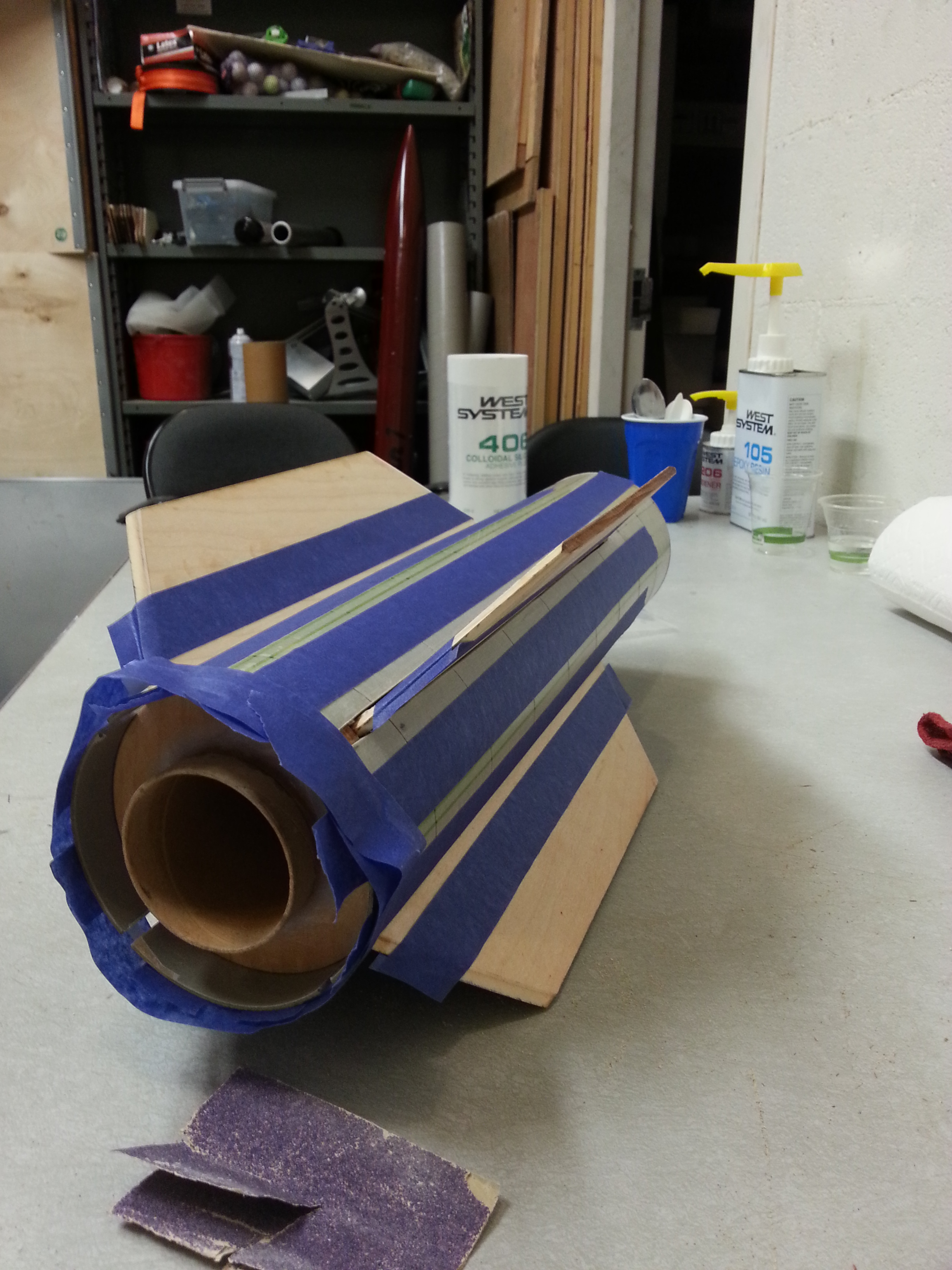 The fin sub-assembly is slid into the airframe and masked off, ready for some more epoxy work.