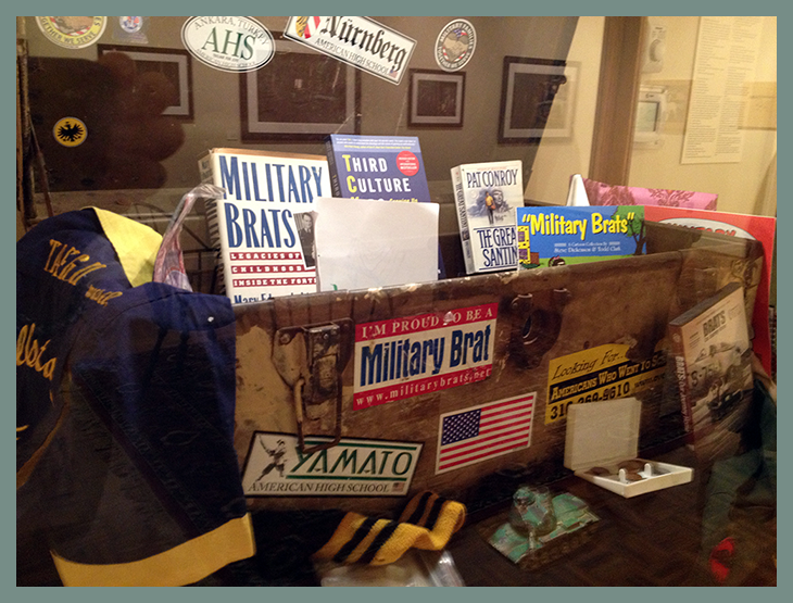 Operation Footlocker on loan from the Museum of the American Military Family contains military brat books and artifacts.