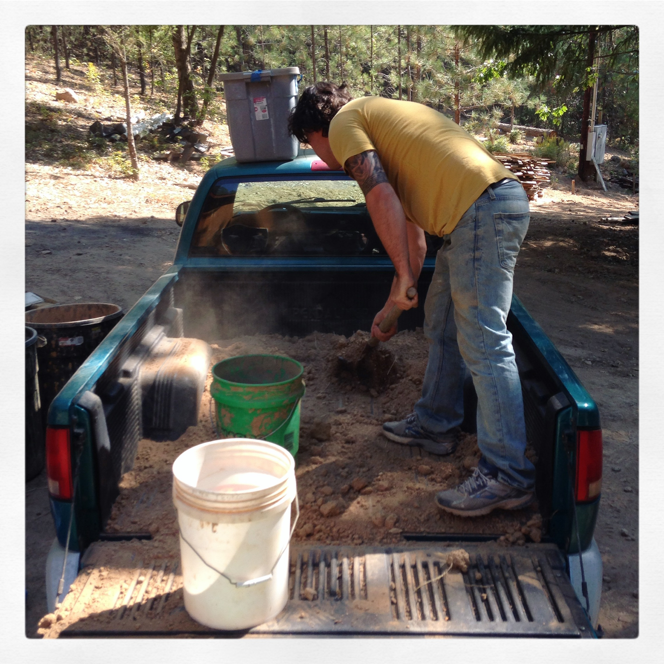 Zach Wollert helping prep clay brought back from Mendocino