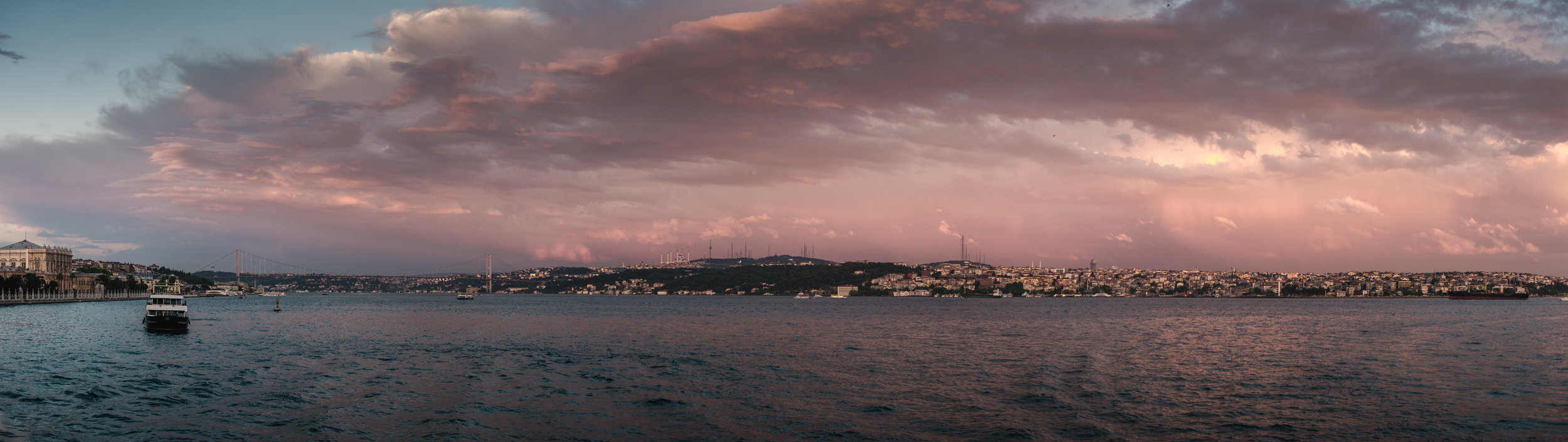 Pink dominated the sky most nights, and I loved how the blue sea was tinted with pink as well. Here you see the European continent just hanging on the left of the image, and the lit Bosphorus Bridge reaches over to the asian continent.
