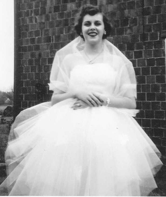 """March 5, 1955 • Youngstown, Ohio • My grandmother, Esther, on her wedding day. I don't have many memories of her. I remember her slumped over in a wheelchair and Mom and Dad giving her some kind of food from a bag into her stomach a lot and watching Jeopardy with her. She also played piano really well. She died of ALS when I was four on September 15, 1989 in Atlanta. As soon as I woke up that day, I ran to my Dad and the exact moment he was crying hearing the news over the phone, I emphatically told him I had a dream the night before. I still remember it to this day: I was riding to the hospice in the backseat of our car to visit Grandma with my family and I saw an angel in the distant sky at sunset carrying my grandmother, slumped over as usual but she was peacefully asleep. I told my Dad, """"Dad! I saw an angel taking grandma to heaven!"""" As soon as my Dad hung up the phone he had a bewildered and almost scared expression on his face. """"What did you just say?!"""" Again I said, """"Dad, I saw grandma in my dream and an angel was taking her to heaven in the sky."""" Then he told me that Grandma had died that night. The only other memories I have is going to the cemetery often to visit her grave. I hated it because it felt sad. Feeding the ducks in the pond was the only fun part."""