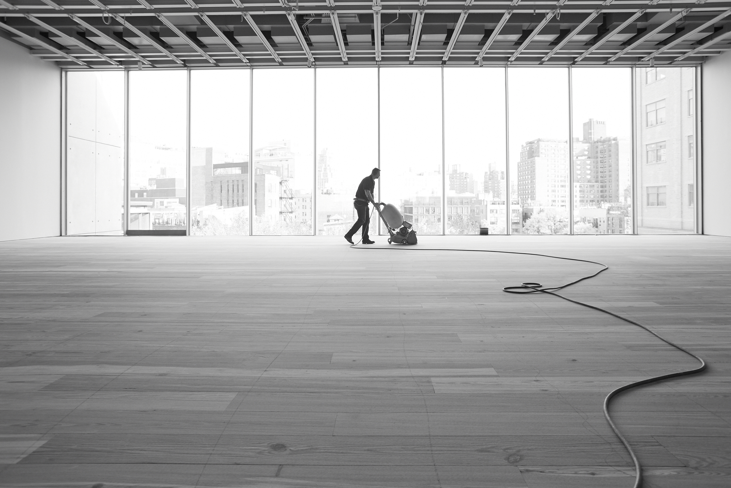 Floor Install, NYC Skyline in the background.