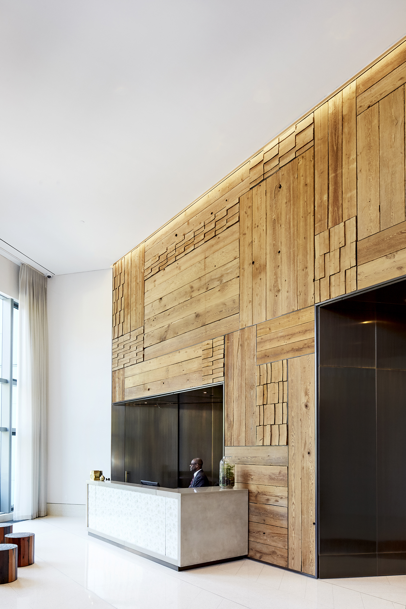 Accent wall in the City Point residential lobby, featuring Hudson Company Reclaimed wood.