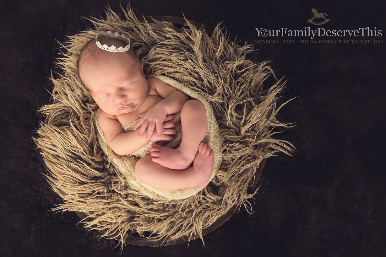 We have cute little newborn crown props and wooden barrel props to snuggle baby into perfect for gorgeous baby portraits.  yourfamilydeservethis.com