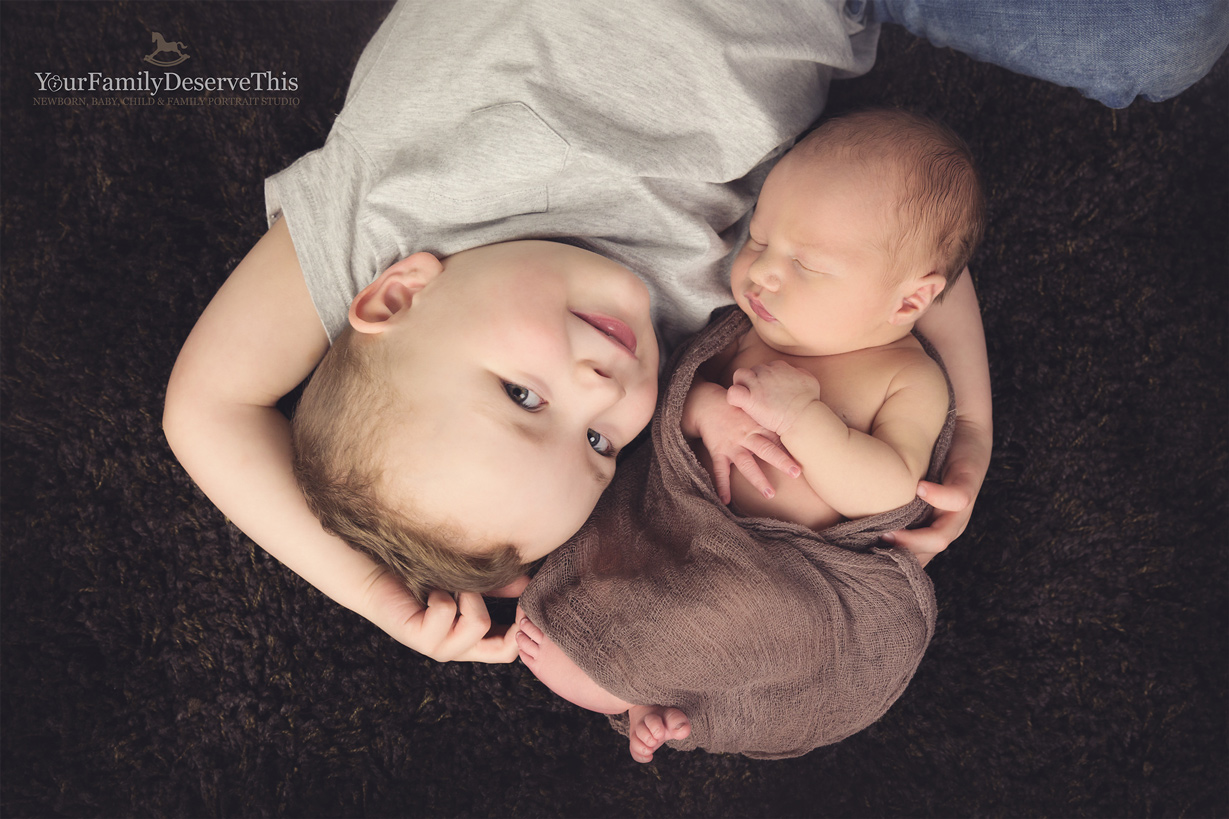 New baby and sibling portraits are so gorgeous to capture, tender moments like this are priceless to their parents and will be cherished by generations.  Winchester Newborn Portrait Photographer.