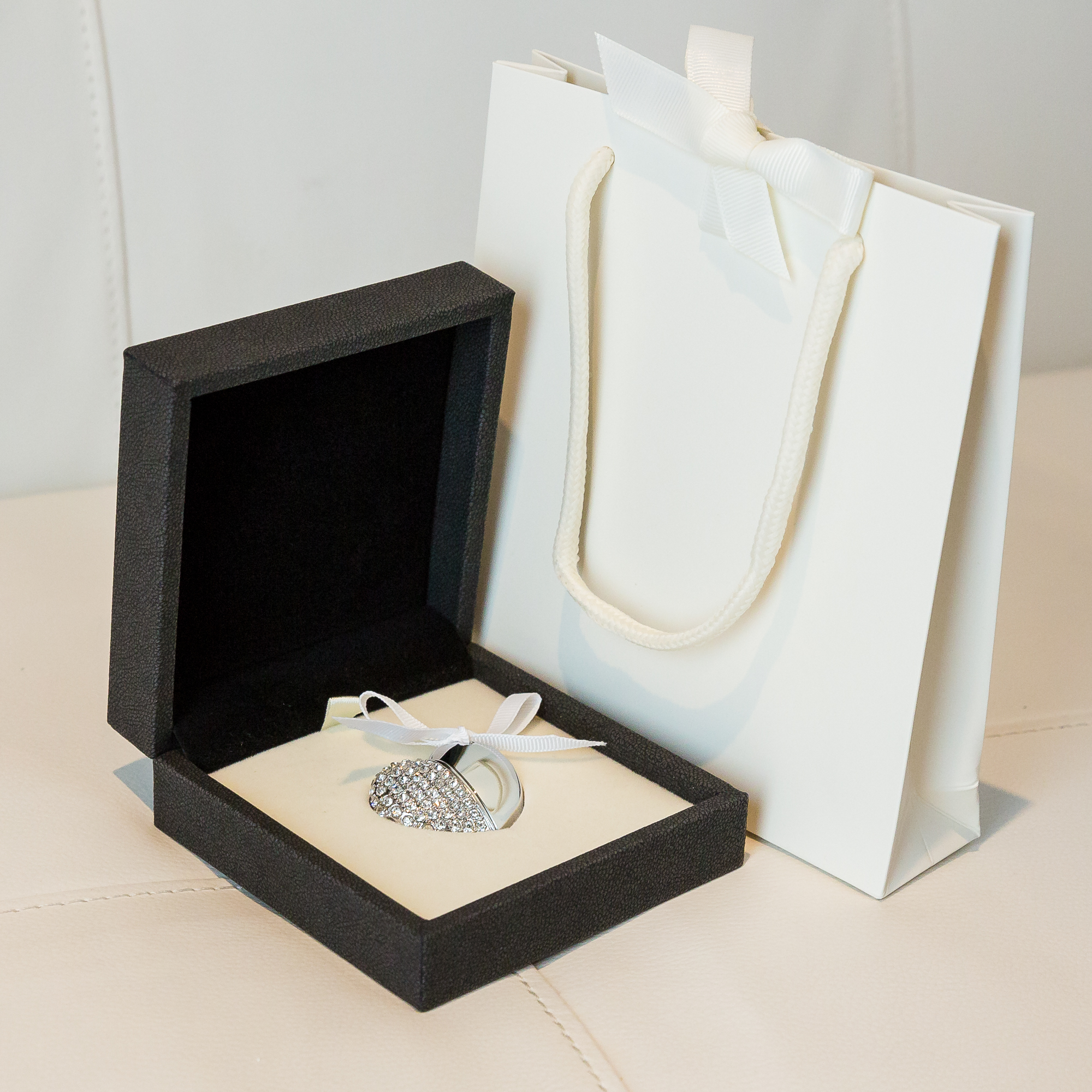 This beautiful Crystal Heart shaped USB comes with your Folio Keepsake Box collection for storage of your digital images.  yourfamilydeservethis.com