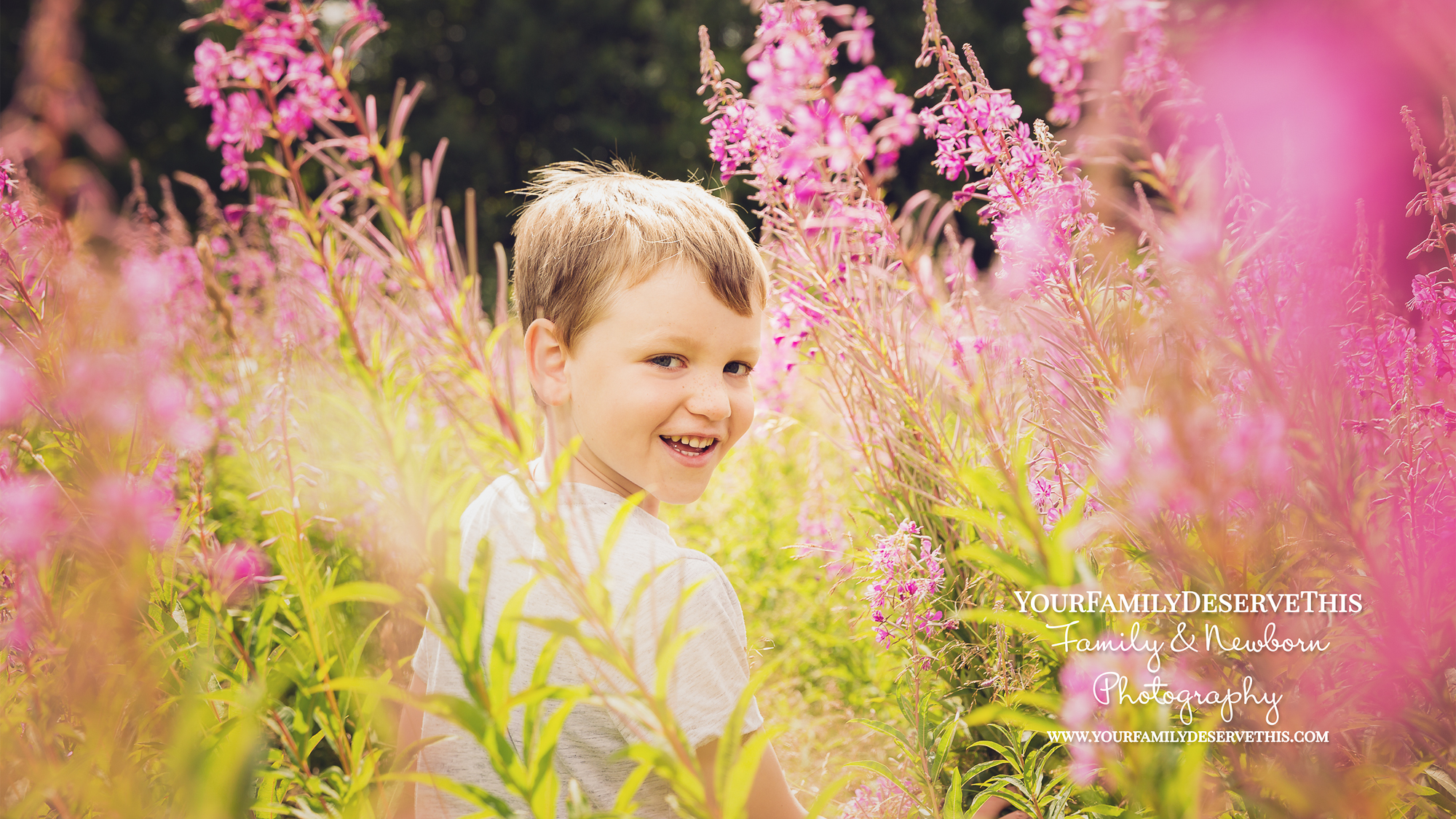 little boy looking back through long pink meadow grass - photographer - YouDeserveThis Headshots, Makeover and Photography Studio Tadley Hampshire.jpg