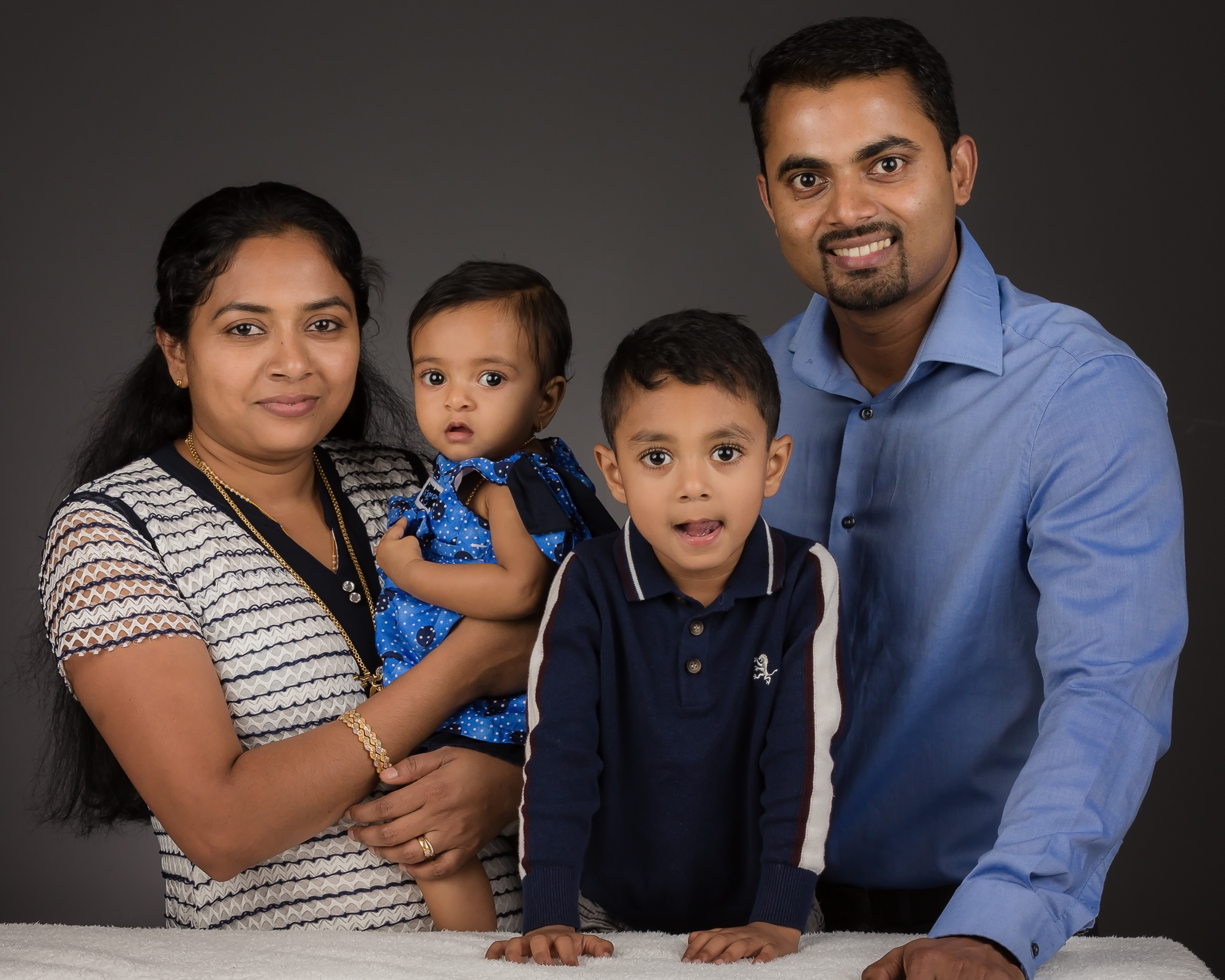 Jijo and Shancy asked us to photograph their beautiful family at our Studio in Tadley  YourFamilyDeserveThis.com