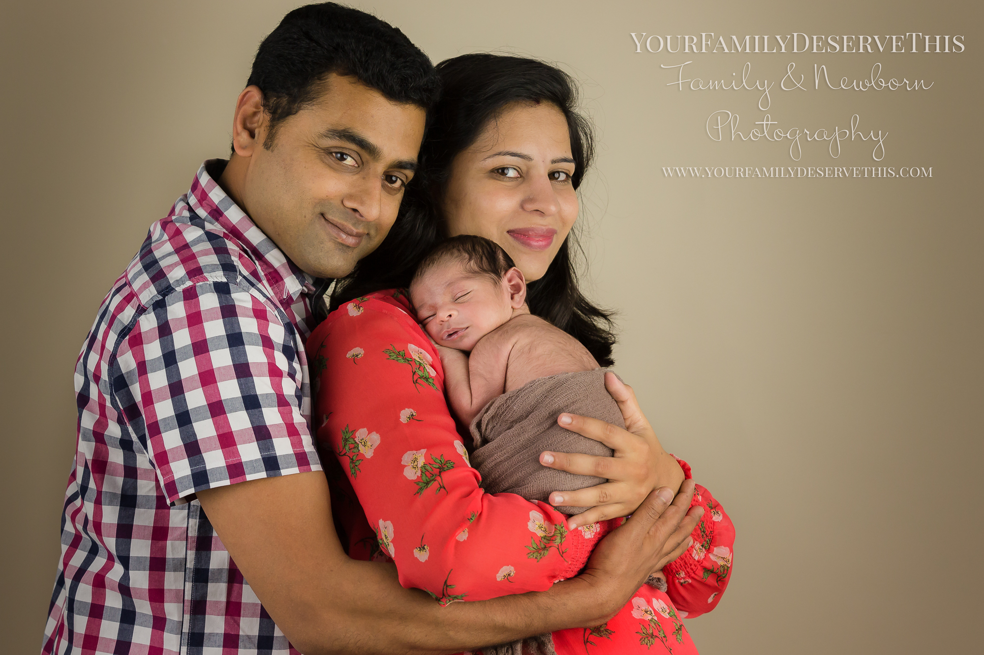 Proud new parents, cuddling their baby son Away - www.yourfamilydeservethis.com
