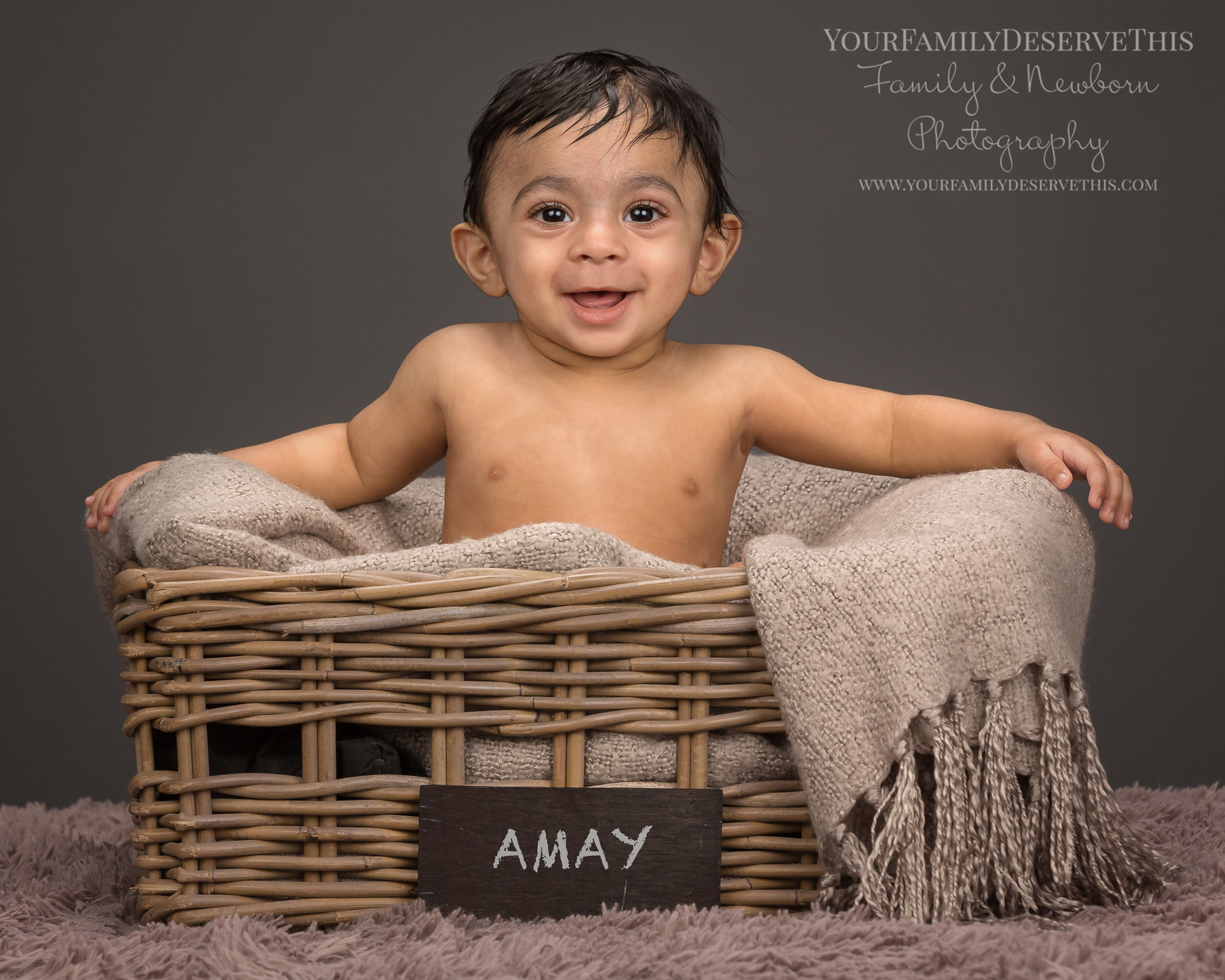 Gorgeous Amay sitting up by himself now, at his  6 month photo shoot , in the same basket as his newborn portraits.