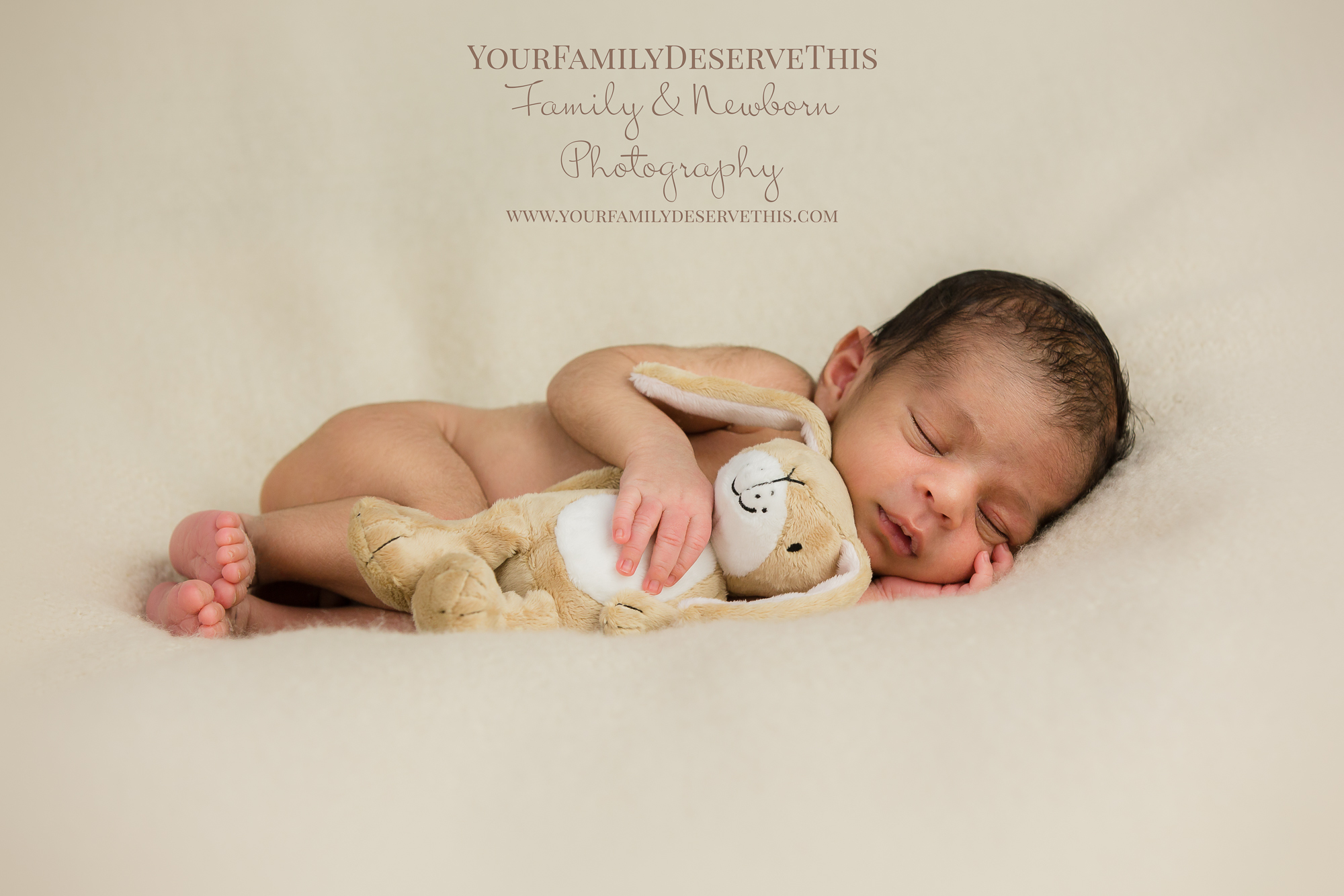 Newborn Amay... only 12 days new. Love how he is cuddling his Little Nut Brown Hare from the story Guess How Much I Love you.  Baby's First Year Photography Package
