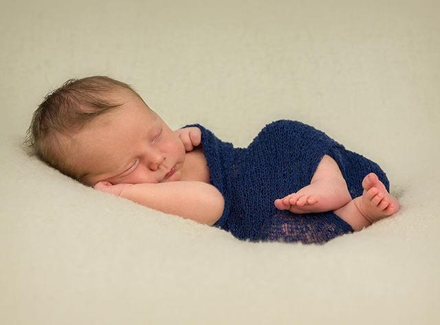 Sweet dreams little one.. beautiful newborn in cute side pose.