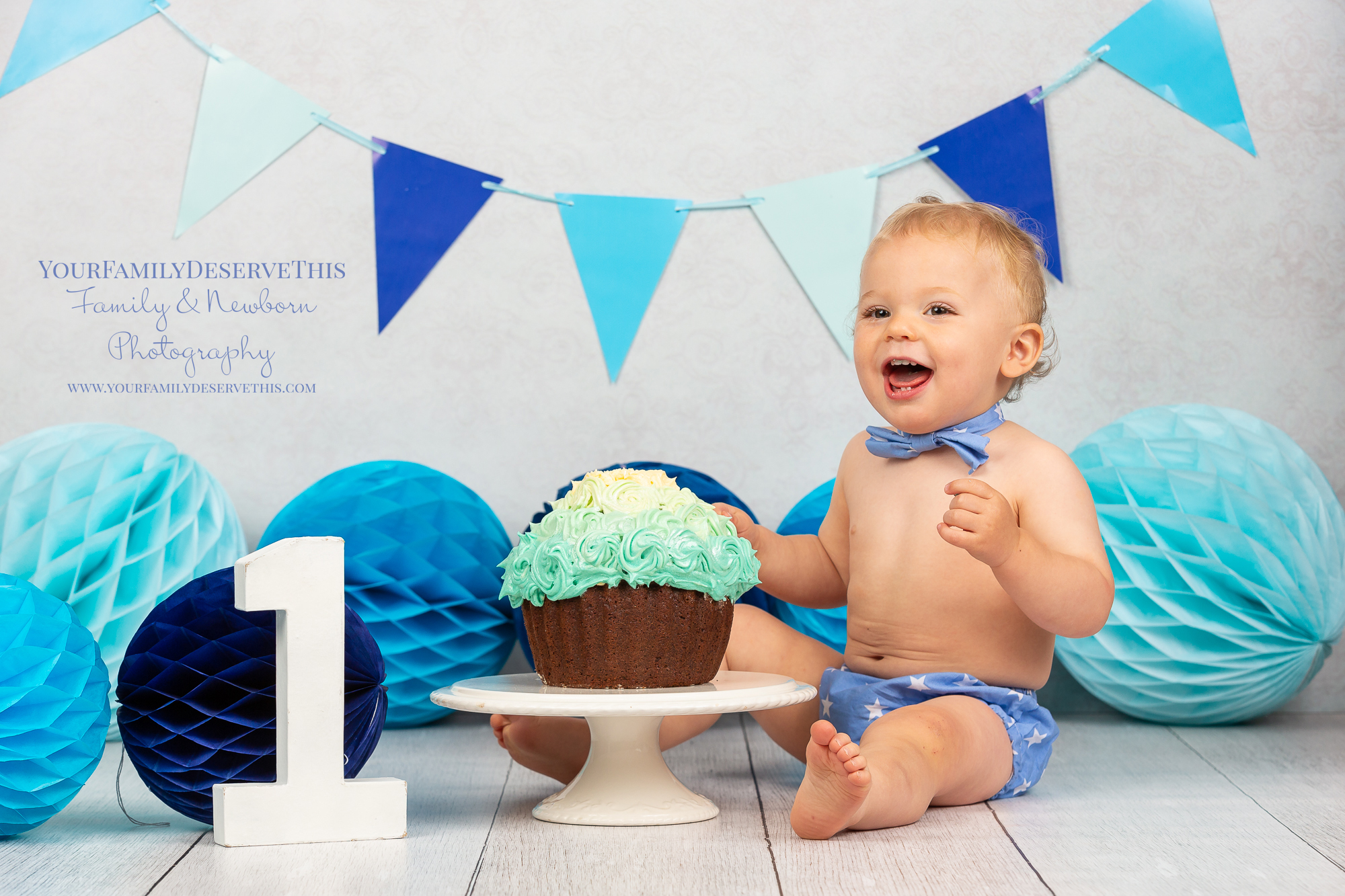 Austin 1st birthday cake smash blue iced chocolate cupcake.jpg