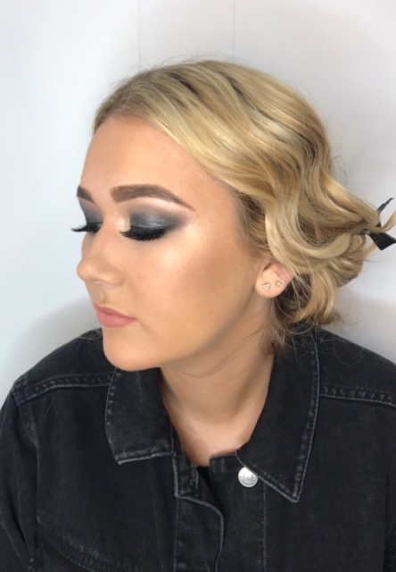Hannah. - Cool smokey eye, blending from the lashline out using MAC shadows, finished with a sweep of pure pigment from Illamasqua. Contoured cheeks with killer highlight from Charlotte Tilbury.