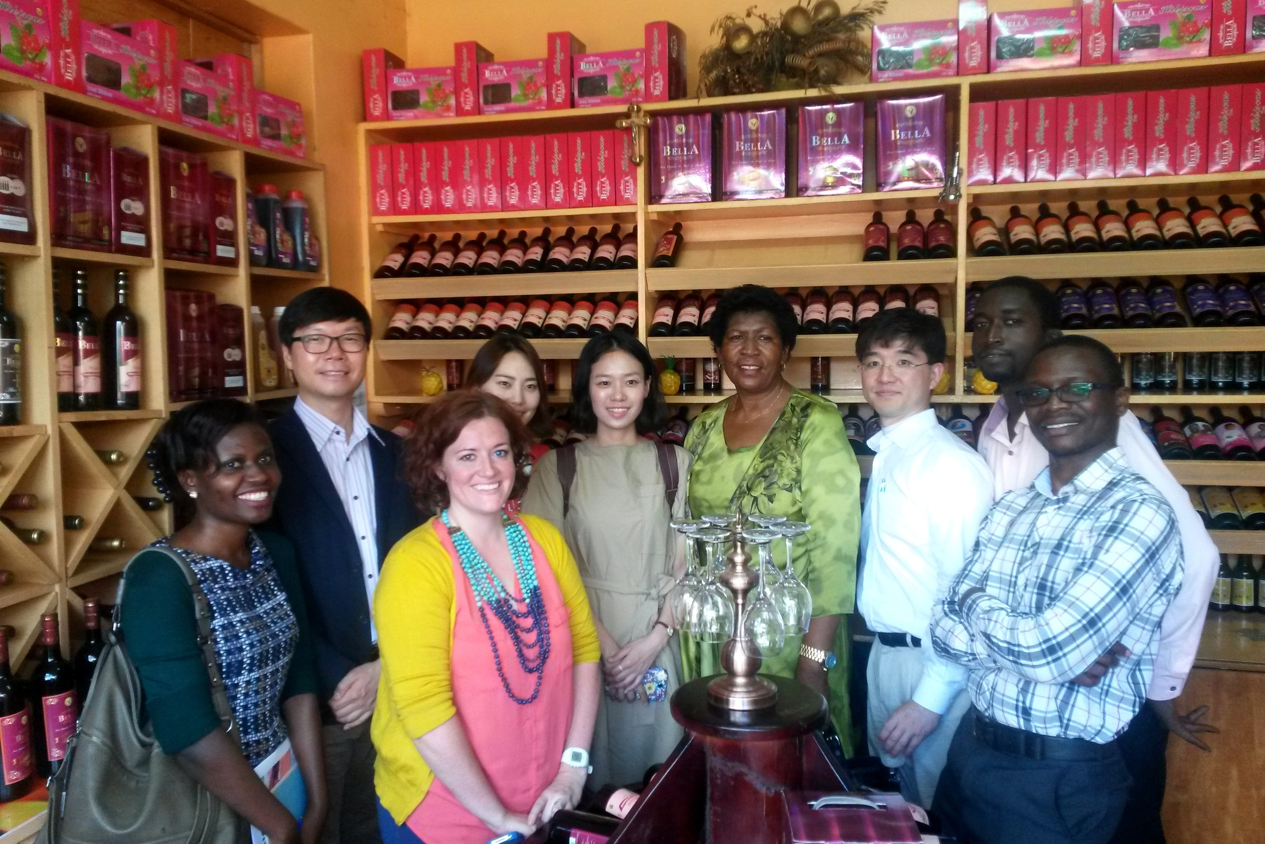 The KOICA-Mango Fund team with Prudence Ukkonika, the owner of K-Roma, client of the KOICA-Mango Fund joint program, in the Bella Wine shop.
