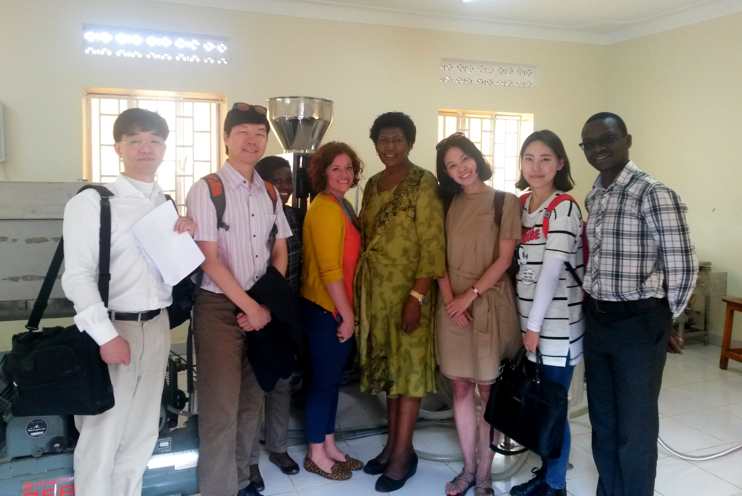 Sujin Kim, Hyun Sang Shin, Kim Jeongtae, Yeji Lee, Liz Lindow and Herbert Kisara with Prudence Ukkonika, the owner of K-Roma, client of the KOICA-Mango Fund joint program, in the Bella Wine factory.