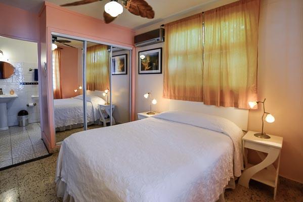 Papaya bedroom, air conditioned with en suite bath