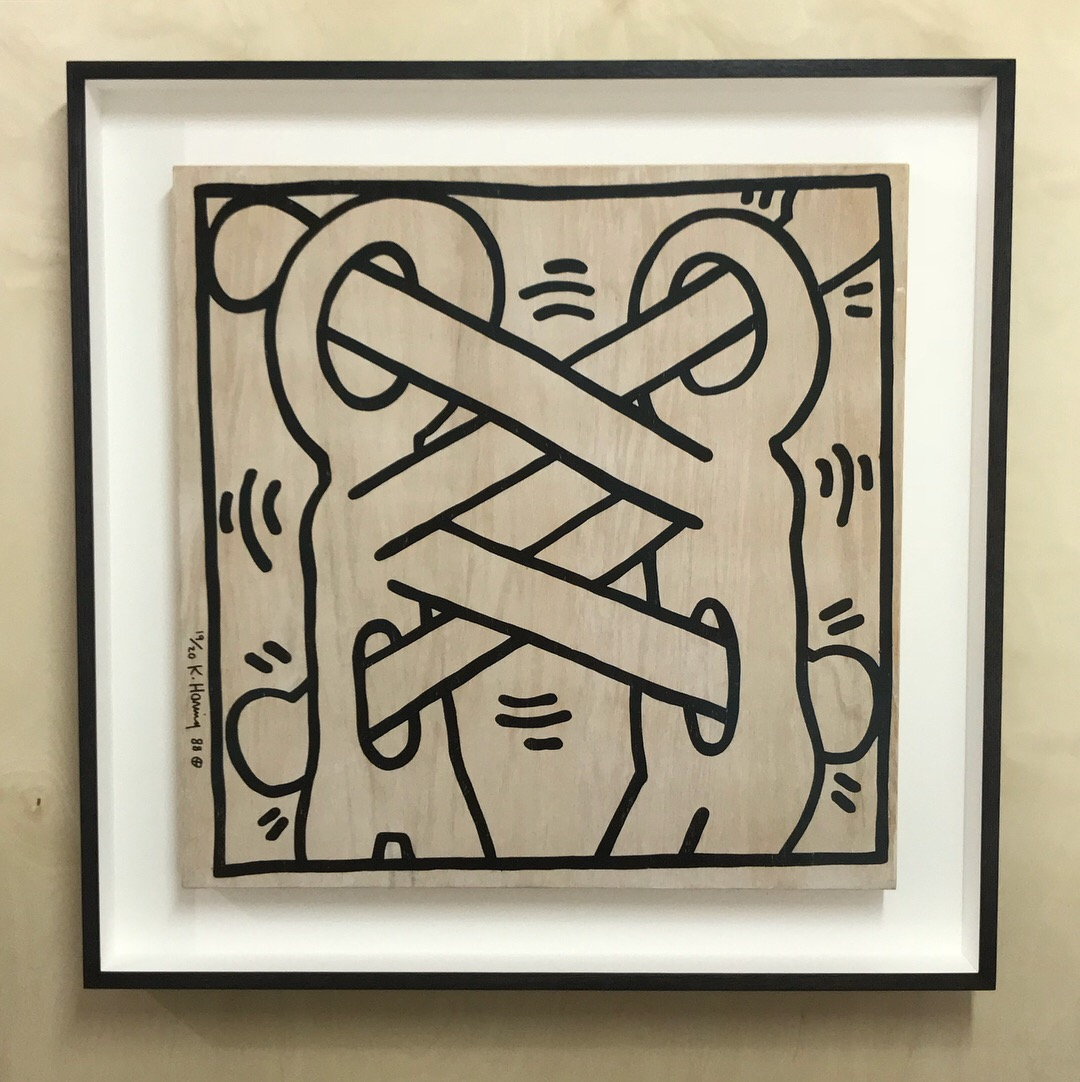 Keith Haring framed in stained Walnut box frame. -