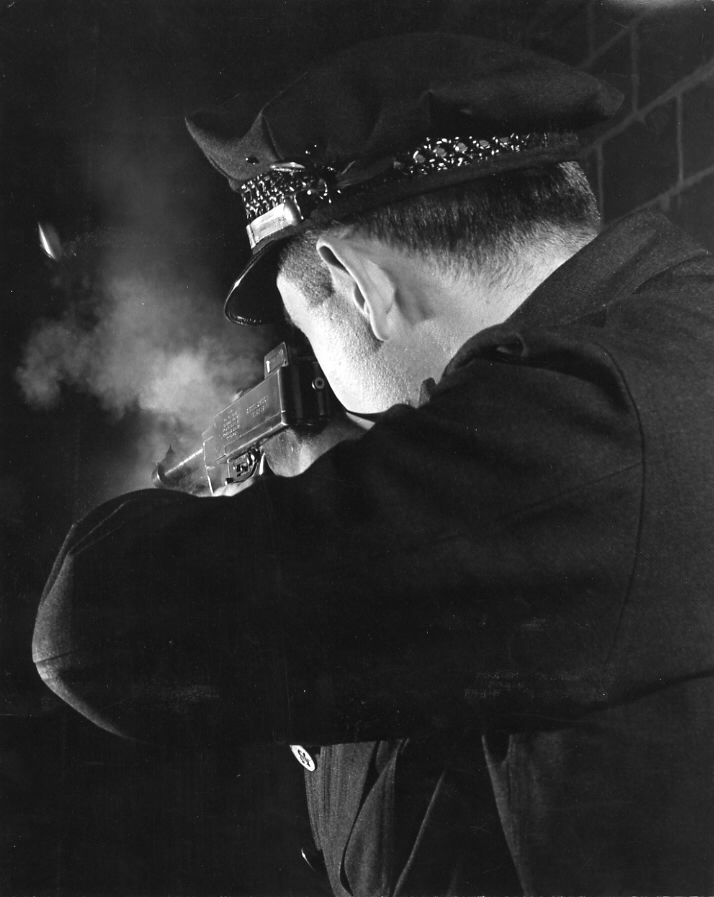 Shooting Range at Brinks Headquarters, Chicago,  1954   Gelatin silver photograph mounted on board.  12 1/2 x 9 7/8 inches