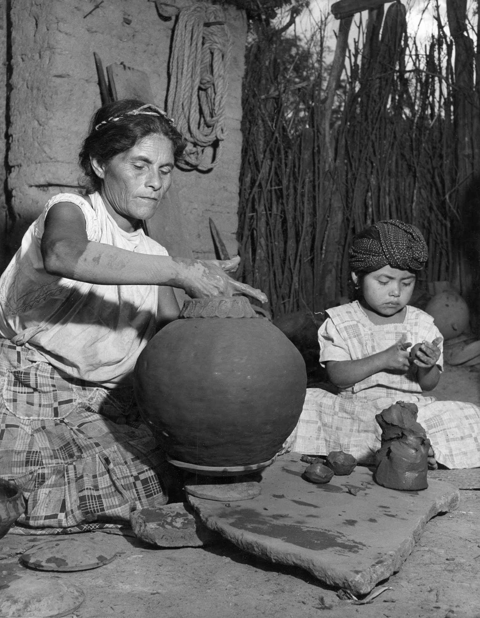 Oaxaca Potters , 1948  Gelatin silver photograph on mount.  13 1/4 x 10 3/8 inches